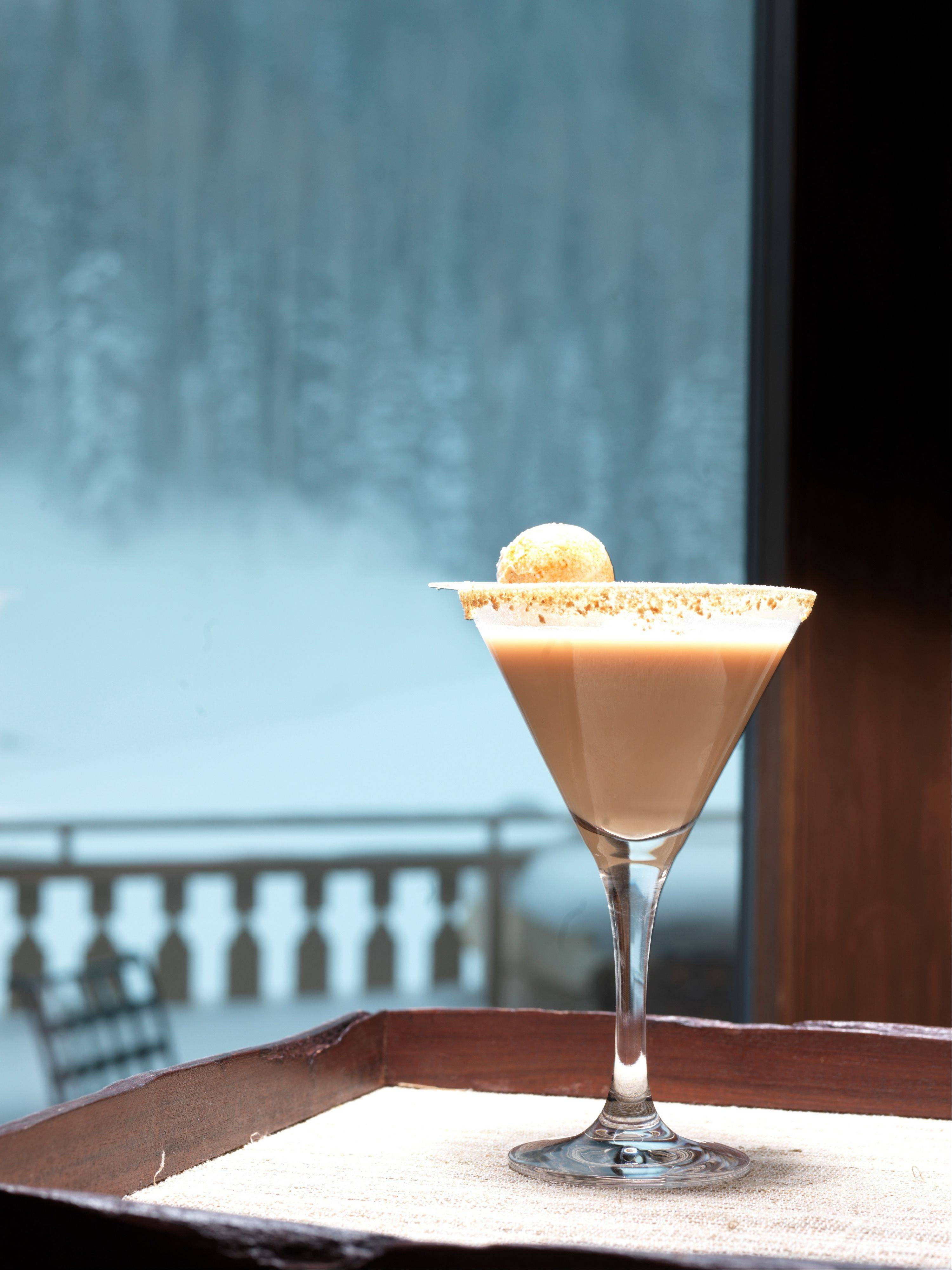 This undated photo provided by the Montage Deer Valley in Park City, Utah, shows a martini served at the resort that's named for S'mores, the classic childhood treat of melted chocolate and marshmallow on a graham cracker. The cocktail includes Baileys Irish cream, vodka, cocoa and graham cracker. It's one of a number of specialty drinks offered for the après ski crowd at resort areas around the West.