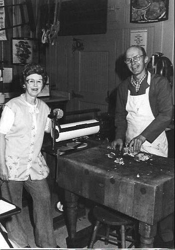Bill Kreger poses with a woman in Kreger's Central Food in Naperville in this undated photo. The family-run meat and deli business has closed after 120 years in business.