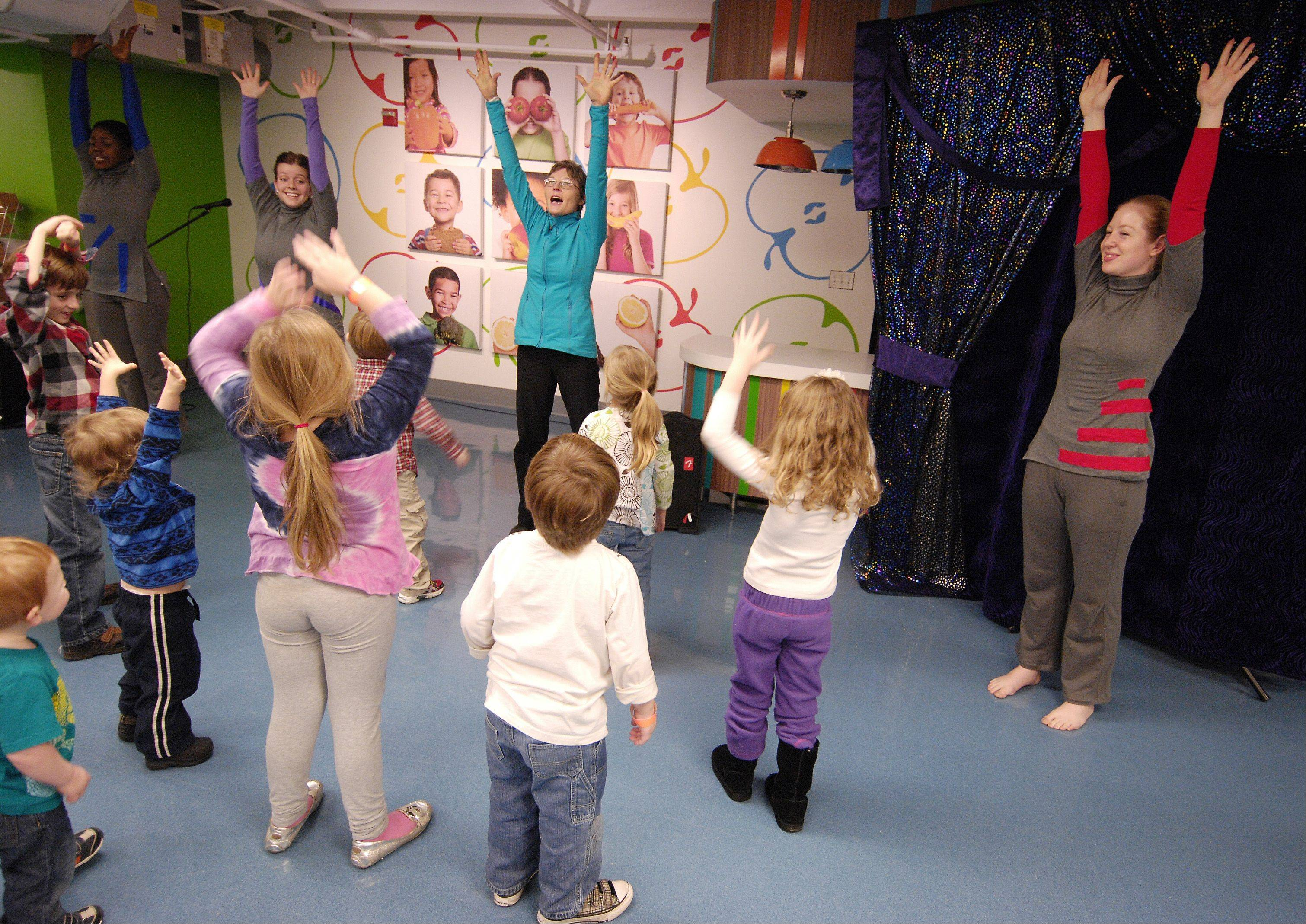 Lin Shook, of Perceptual Motion Dance Company, leads children in some interactive activities during a performance Sunday at the DuPage Children's Museum in Naperville.