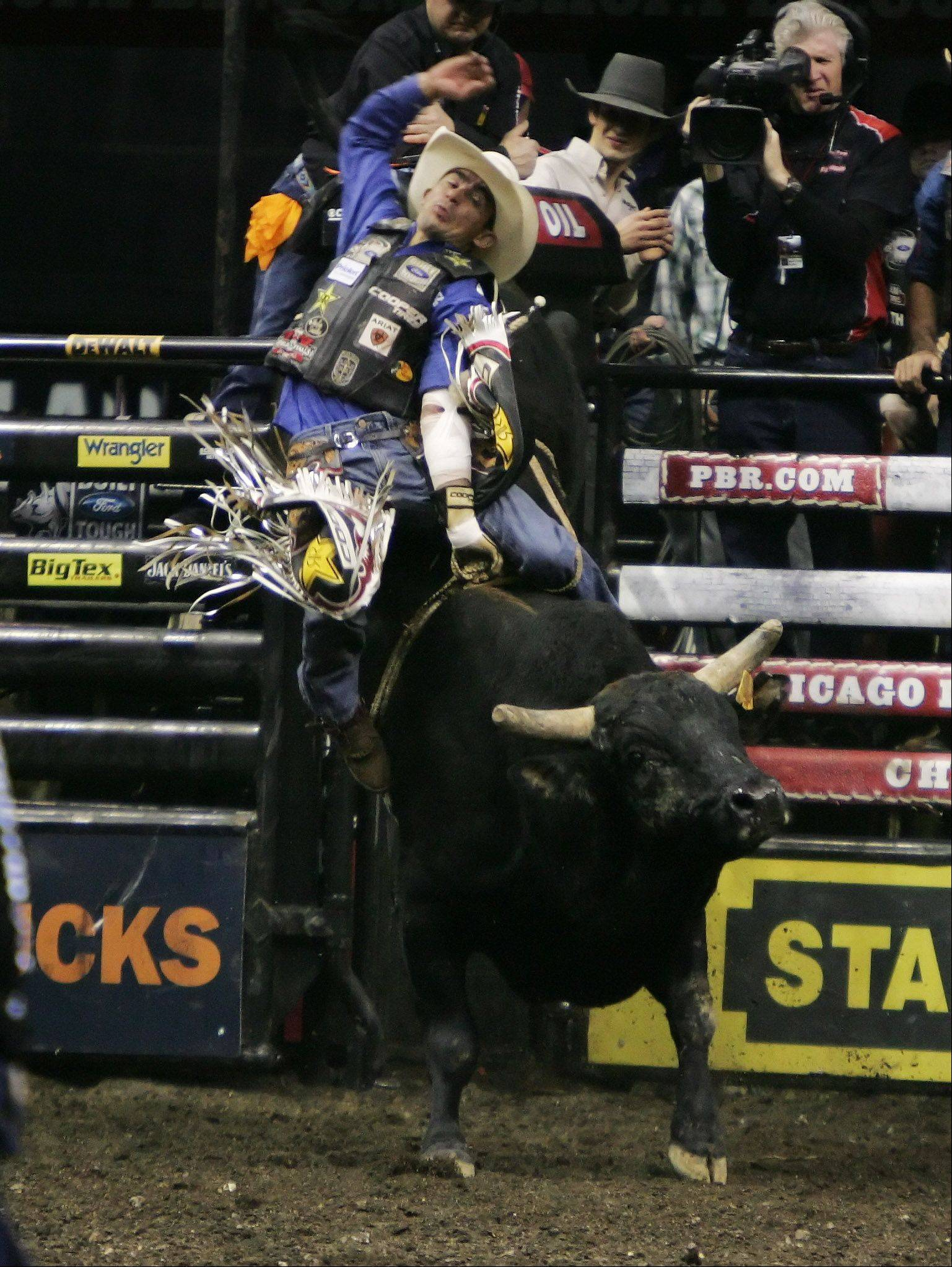 Renato Nunes rides Santiago during the Professional Bull Riders Chicago Invitational Sunday at the Allstate Arena in Rosemont. Riders from around the world competed in the arena by riding 2,000-pound bulls.