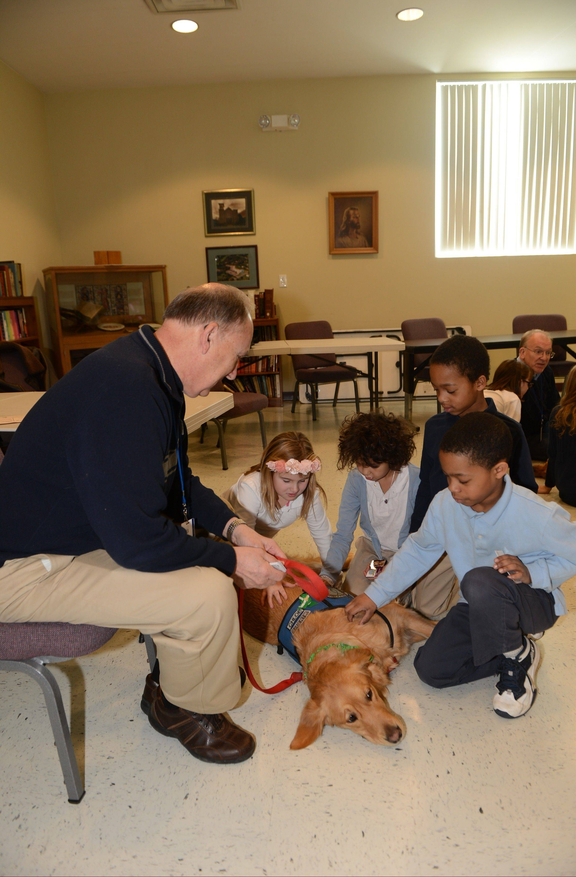 George Schiestel of Arlington Heights and comfort dog JoJo visit with children at the Lutheran school in Danbury, Conn., this month following the school shootings in nearby Newtown. They also visited children who were in the school where the shootings occurred.