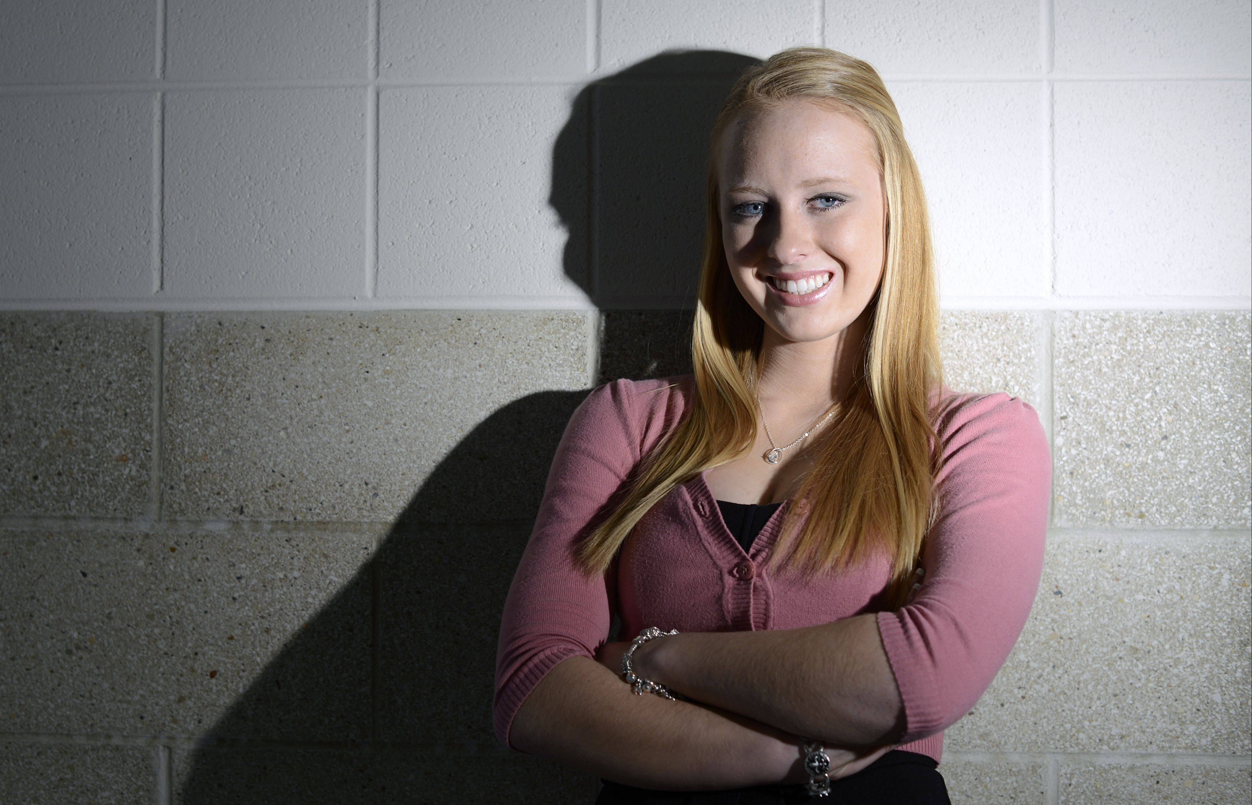 Daniela Kapusta, 17, of St. Charles, was recently featured in Vogue Italia. She says she spent much of her time at St. Charles East High School in the depths of depression due to frequent bullying. Things have turned around in her senior year. She is a student adviser on the board of a suicide prevention club. While helping out at a charity fashion show, she modeled a dress which brought her to the attention of the fashion industry.