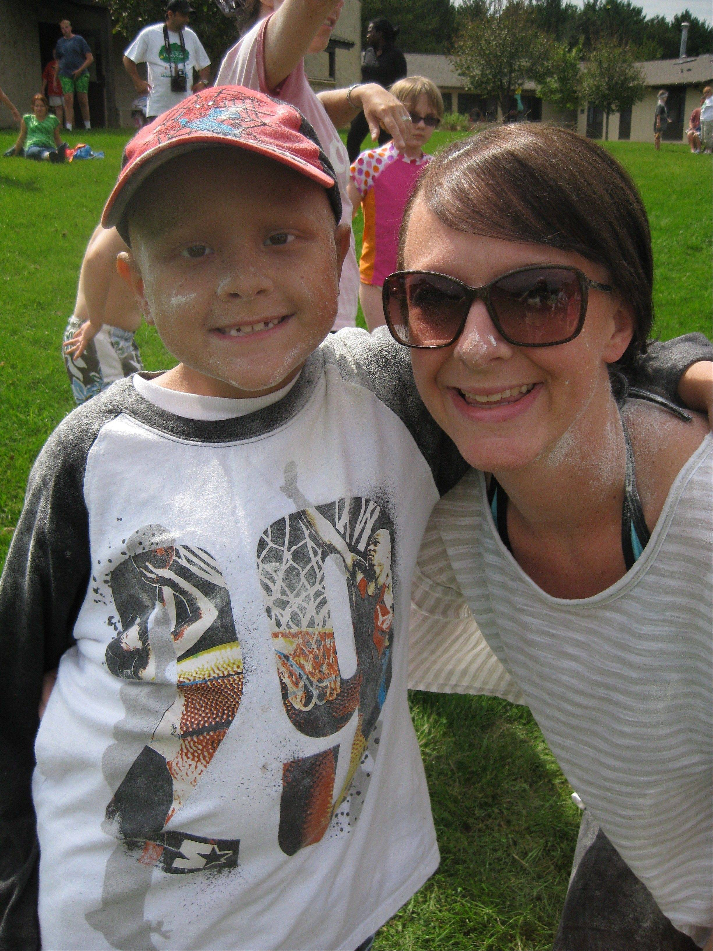 "A beloved counselor who helps kids with cancer have fun at the One Step Camp in Wisconsin, 27-year-old Bartlett native Colleen McGrath has dedicated her life to the camp, which she credits for ""saving my life"" after she was diagnosed with pancreatic cancer at age 13."
