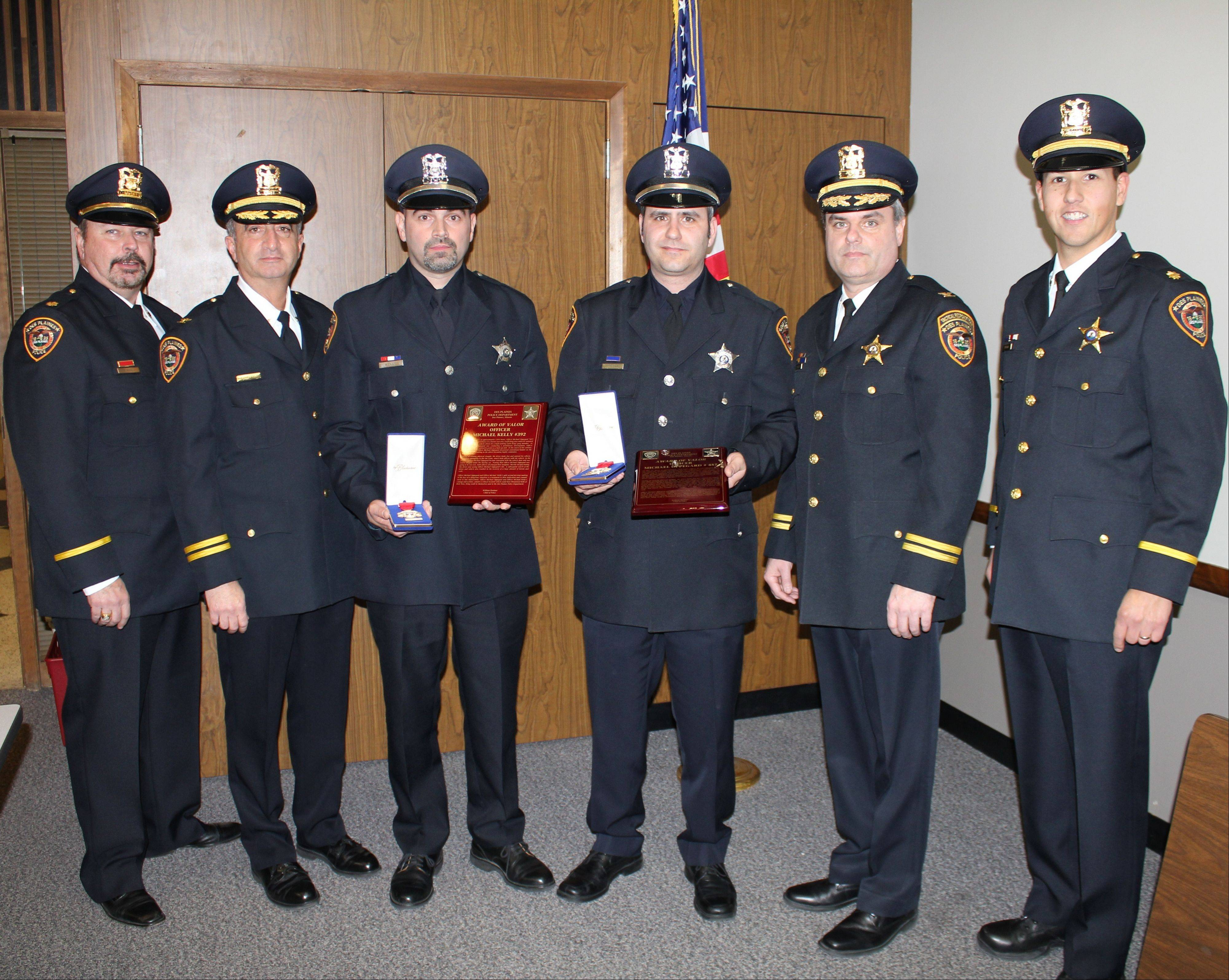 From left, Des Plaines Police Cmdr. Randy Akin, Deputy Chief Nick Treantafeles, officers Michael Kelly and Michael Oppegard, Deputy Chief Michael Kozak and Cmdr. Louis Wittmer are pictured here during a Jan. 7 presentation of the Award of Valor to Kelly and Oppegard at the monthly city council meeting.