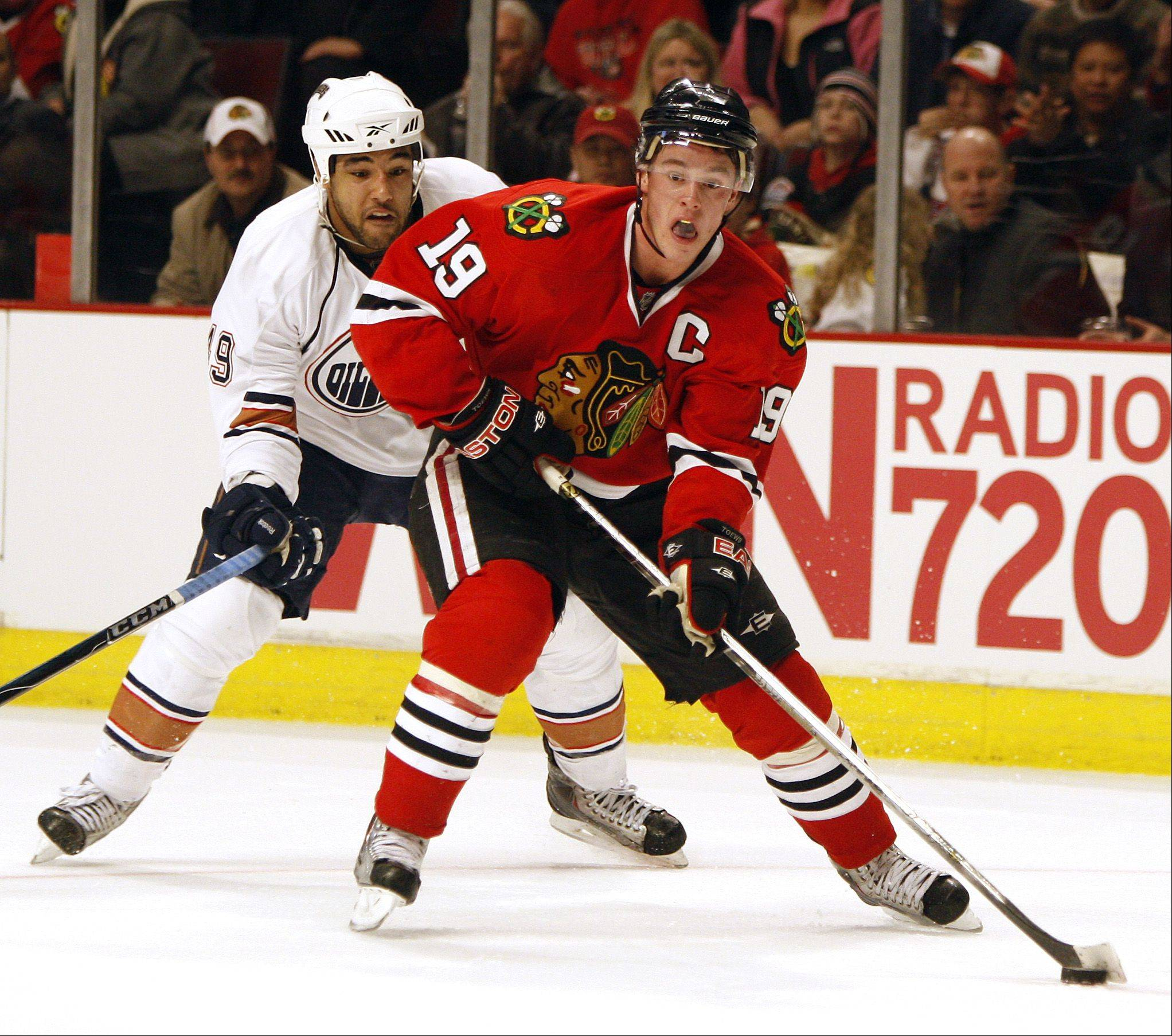 "Blackhawks captain Jonathan Toews was a vocal critic of the NHL during the lengthy lockout. On Sunday, Toews said, ""All that is behind us now. I would rather talk about hockey and the great things that are going to happen this season."""