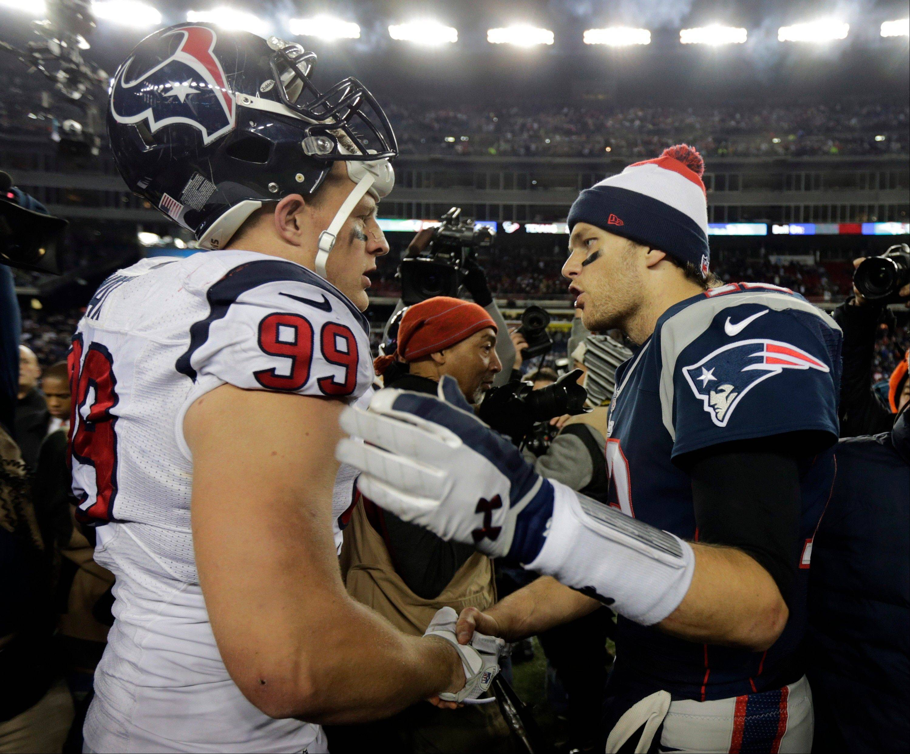 New England Patriots quarterback Tom Brady, right, talks with Houston Texans defensive end J.J. Watt following their AFC divisional playoff NFL football game in Foxborough, Mass., Sunday, Jan. 13, 2013. The Patriots defeated the Texans 41-28.