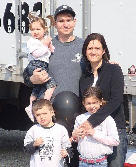 Two Men and a Truck owners Paul and Kristy Brown with their children, from left, Jamie, 4, Luke, 7, and Haley 10.