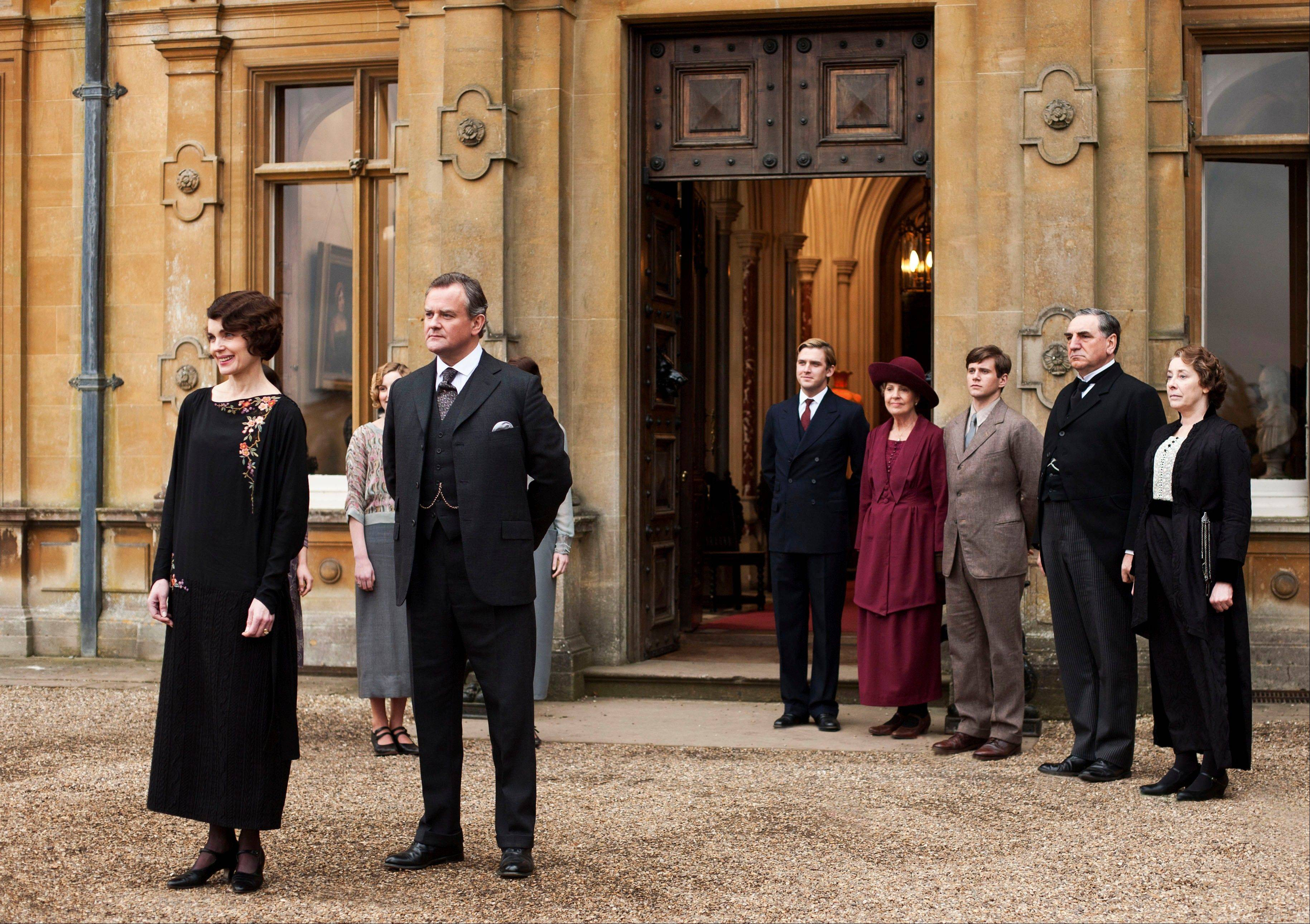 "This undated publicity photo provided by PBS shows, from left, Elizabeth McGovern as Lady Grantham, Hugh Bonneville as Lord Grantham, Dan Stevens as Matthew Crawley, Penelope Wilton as Isobel Crawley, Allen Leech as Tom Branson, Jim Carter as Mr. Carson, and Phyllis Logan as Mrs. Hughes, from the TV series, ""Downton Abbey."" On Jan. 29, the final three episodes of Downton Abbey Season 3 will be available to iTunes Season Pass holders in the US and Canada before the episodes air on TV."