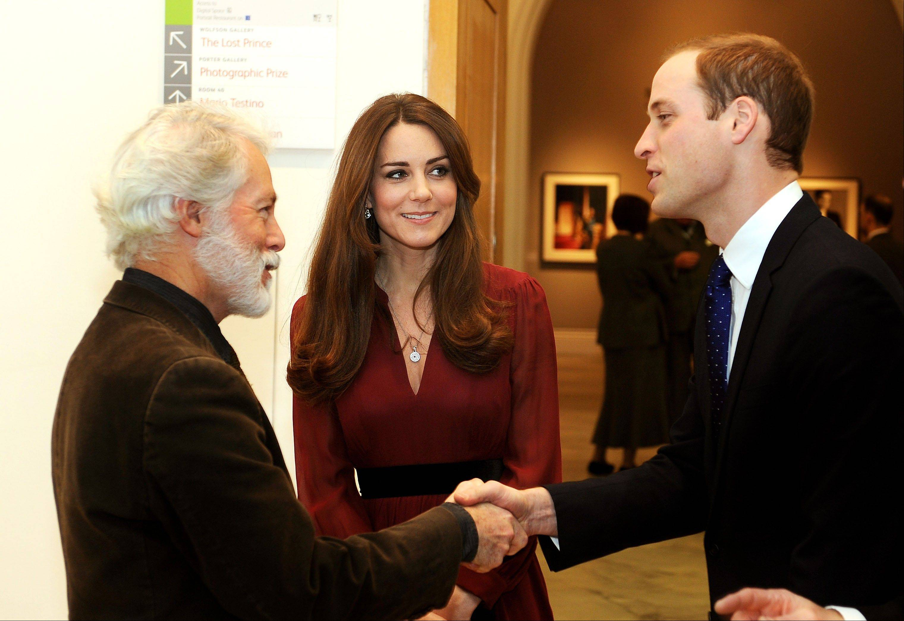The Duke and Duchess of Cambridge meet artist Paul Emsley after viewing the newly commissioned portrait of The Duchess of Cambridge at the National Portrait Gallery in central London on Friday. Kate has resumed public appearances after being treated for acute morning sickness last month.