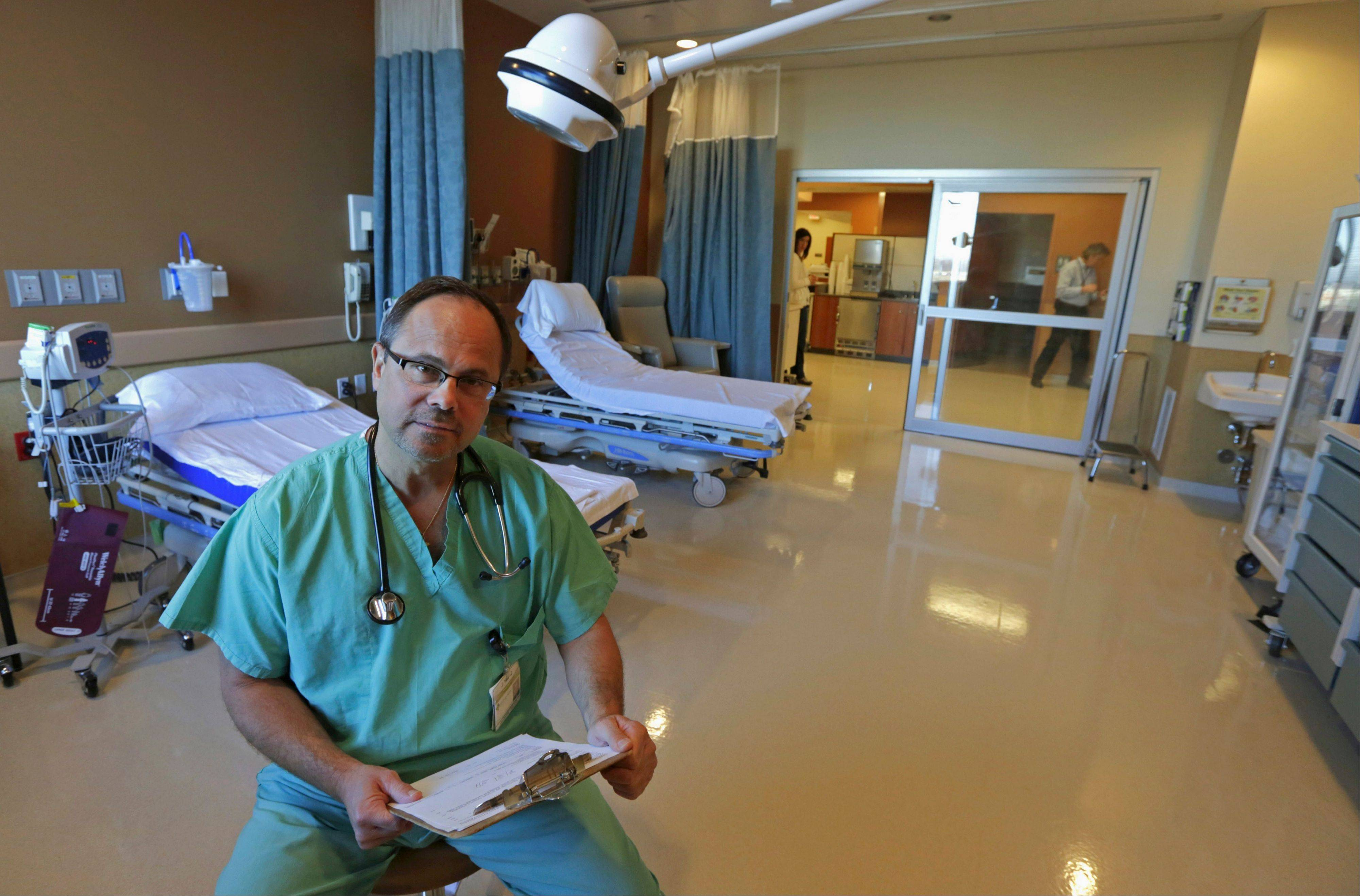 Dr. Daniel Checco sits in the critical care procedure room at Silver Cross Emergency Care Center in Homer Glen.