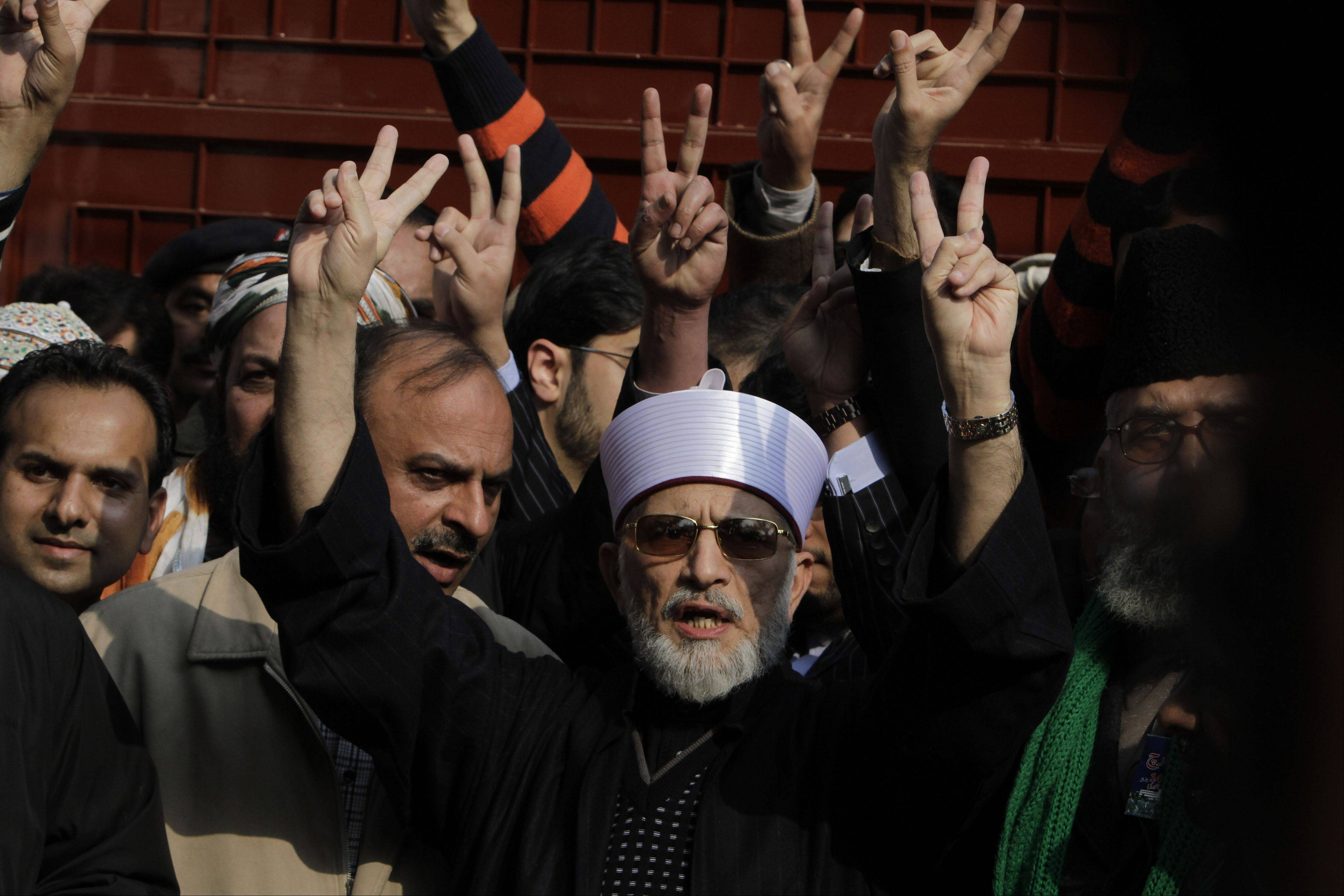 Pakistani Sunni Muslim cleric Tahir-ul-Qadri, 61, center, leaves Lahore to lead an anti-government march to the capital Islamabad, Pakistan, Sunday. After years in Canada, Qadri returned to Pakistan last month and gave a speech demanding that sweeping election reforms be implemented before elections this spring.