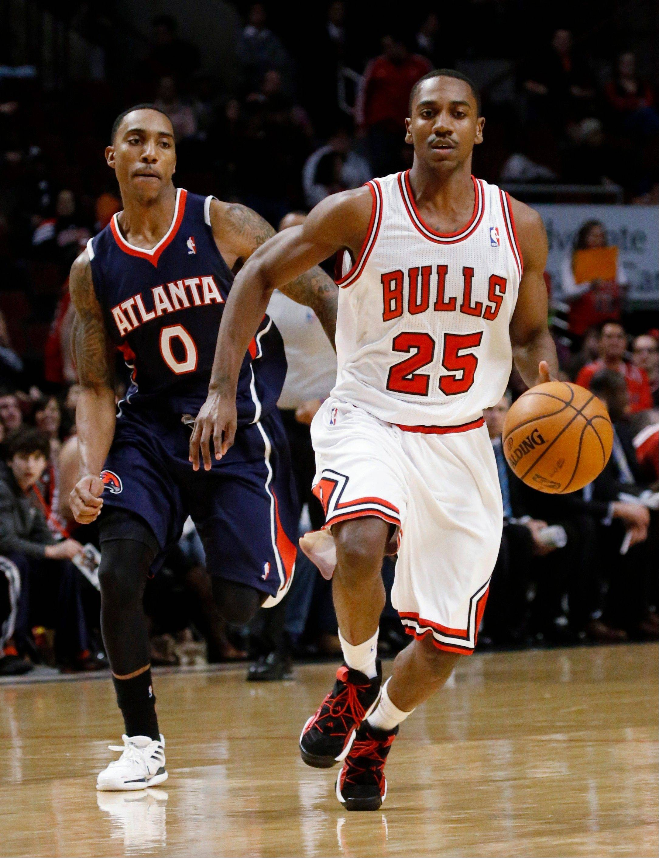 Bulls guard Marquis Teague drives past Atlanta Hawks guard Jeff Teague, his brother, during the second half of an NBA basketball game Monday, Jan. 14, 2013, in Chicago. The Bulls won 97-58.