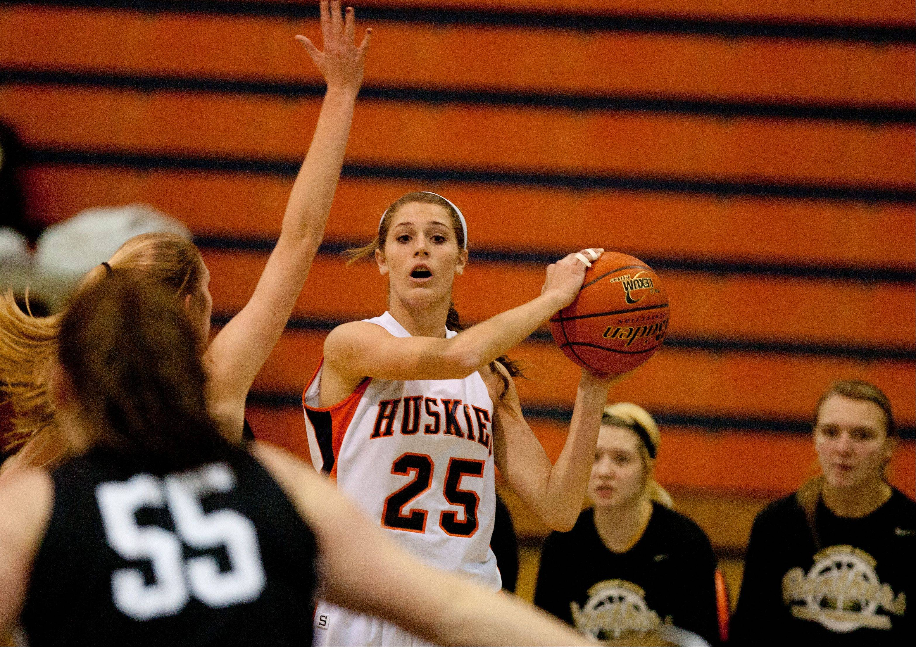 Naperville North�s Kayla Sharples looks to pass the ball.