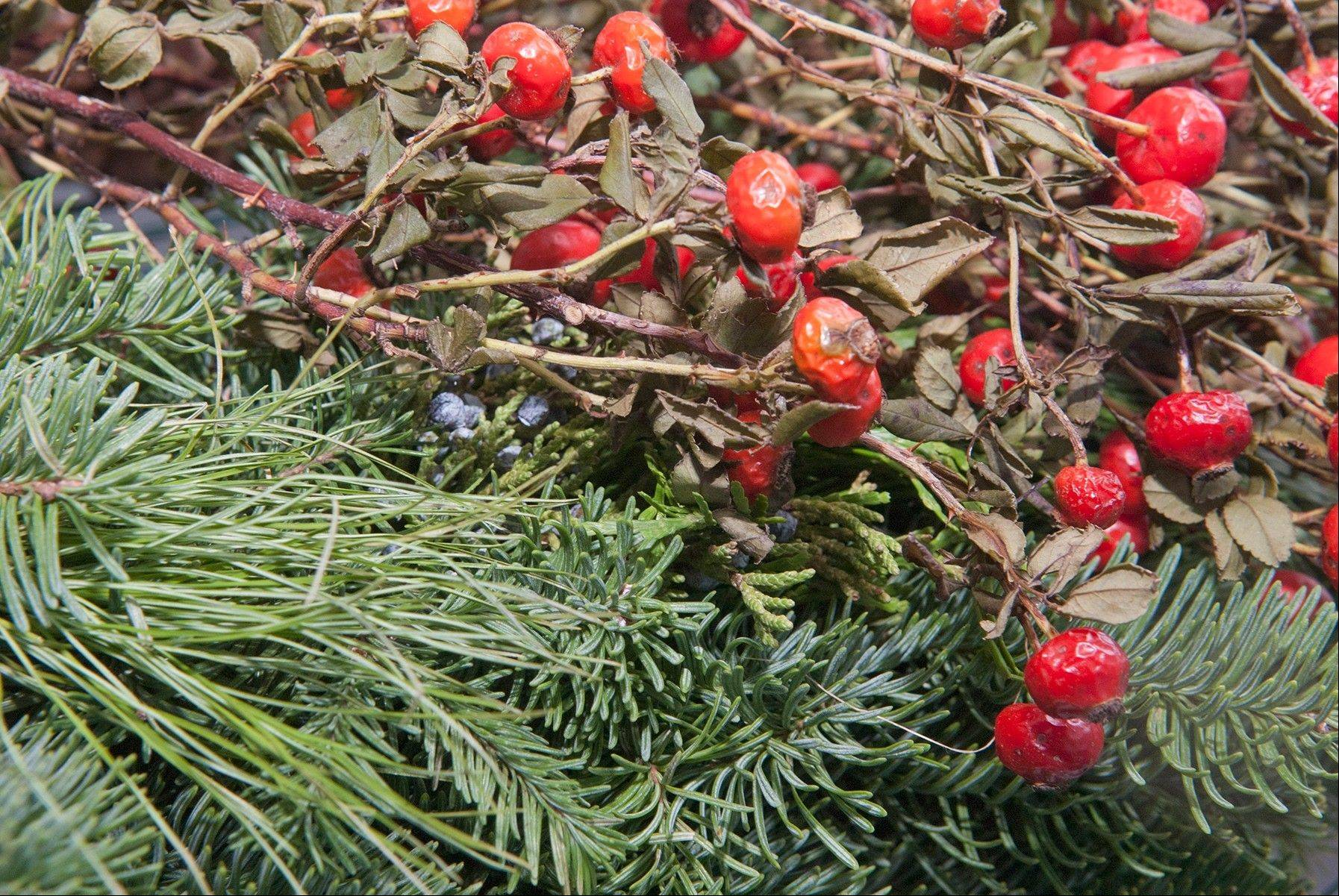 Natural holiday decor can be recycled into your mulch pile. Remember to first remove unnatural items such as tinsel and wire.