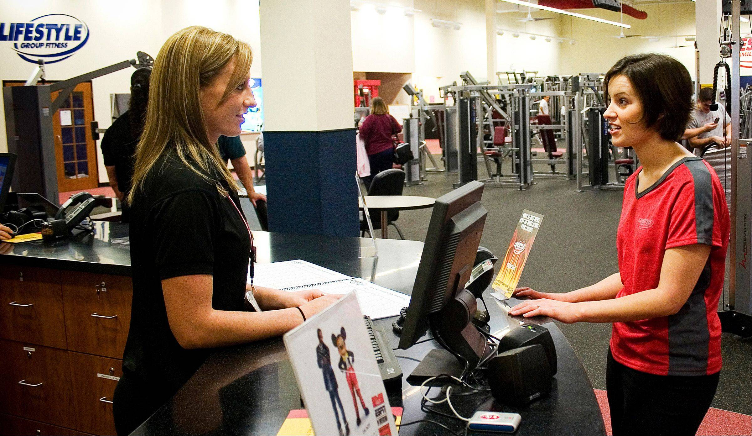 Emily Scherpf, left, and Kate Rahman negotiate a personal training package at the Lifestyles Family Fitness in Valrico, Fla.