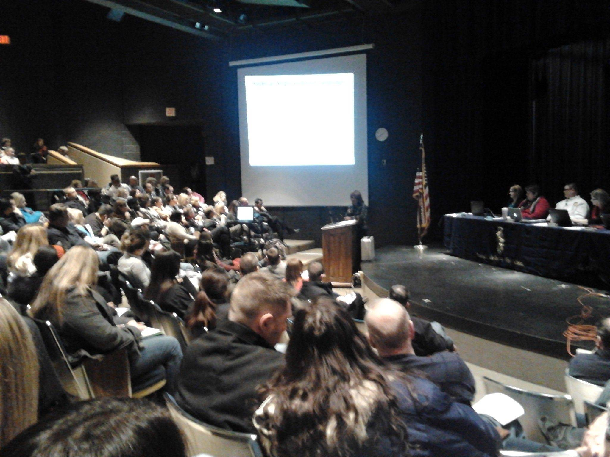 More than 250 spectators listen Monday to Round Lake Area Unit District Superintendent Constance Collins discuss a need to restructure due to poor academic performance.
