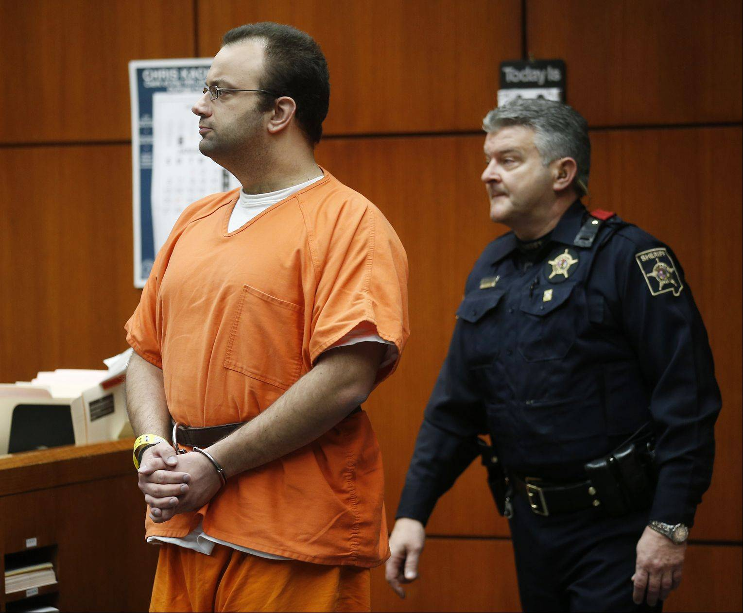 Joseph Spitalli enters a DuPage County courtroom for his arraignment on murder charges. The Darien man is charged with the Nov. 16 slaying of Teymur Huseynli, who was dating Spitalli´s former girlfriend.
