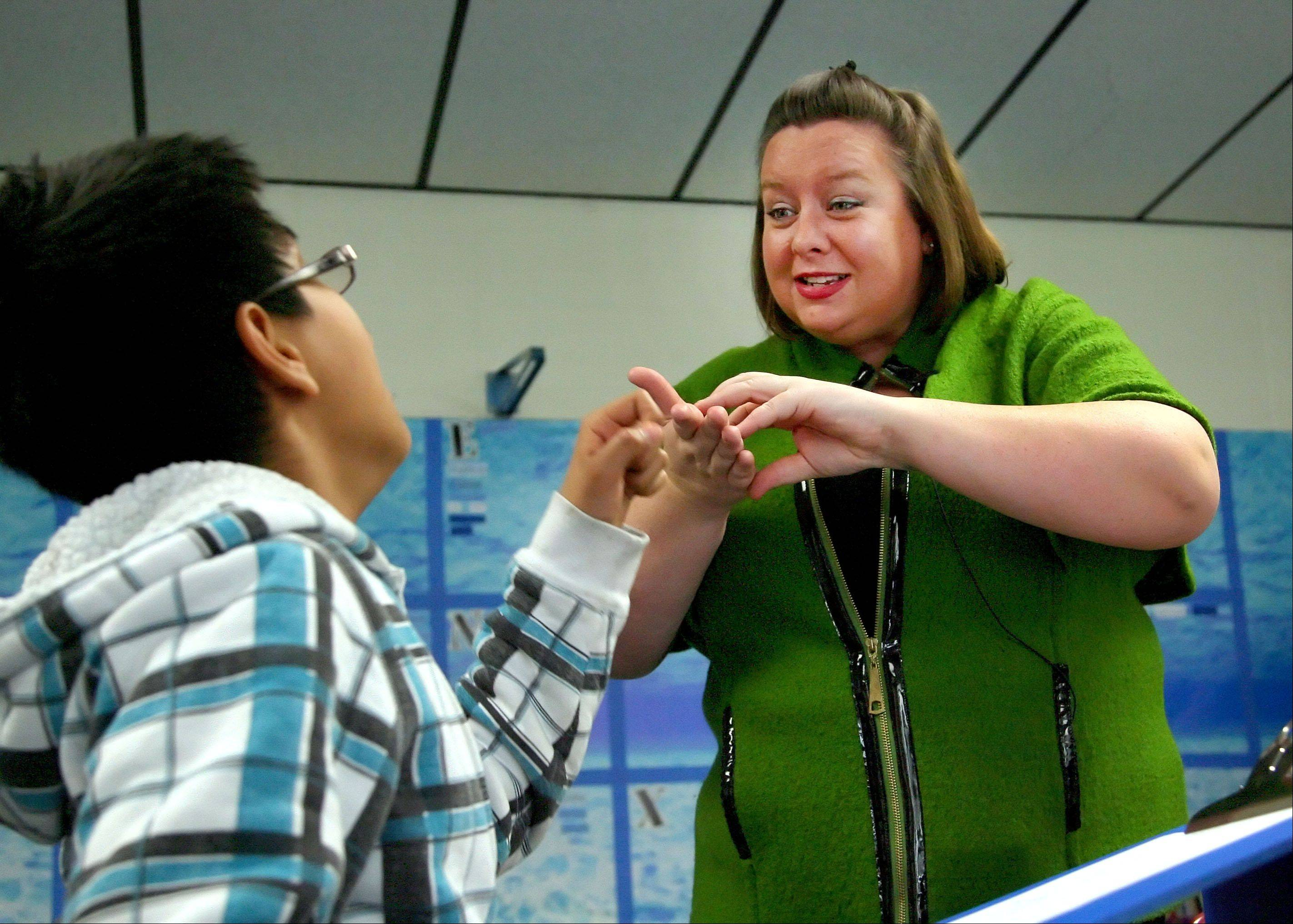 Abbie Currie, a teacher of the deaf and hard of hearing, works with seventh-grader Diego Mendez in her class at the John Powers Center in Vernon Hills. She engages students with an expressive style.