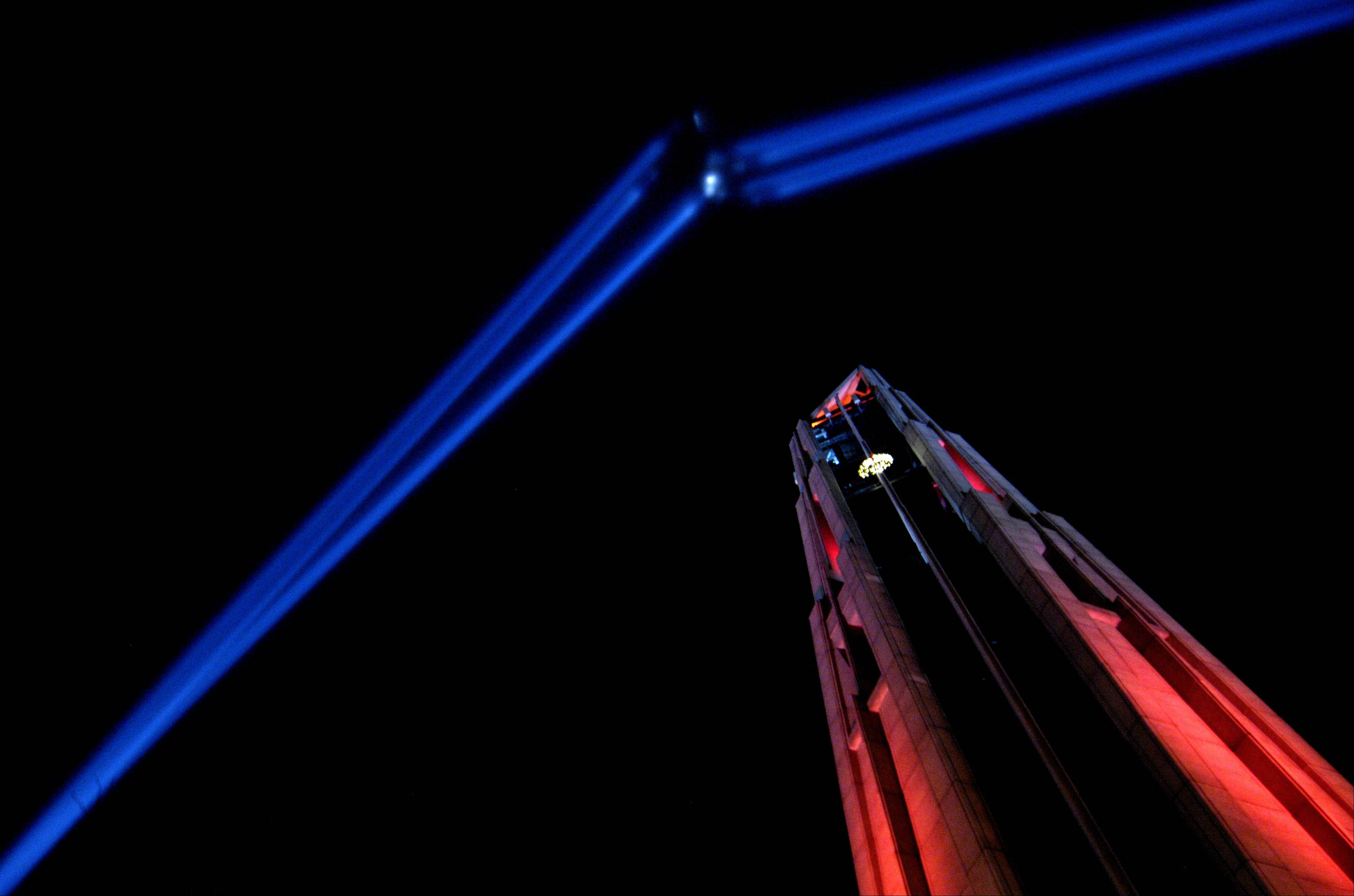 I was drawn to make this image of the colored light show at the Naperville Millennium Carillon on New Year's Eve as soon as I stepped into the park and saw the potential of the scene. I purposely framed the scene so the spotlight beams came from two corners and the Carillon rise out of a third corner. This image was taken hand held with a slow shutter speed.