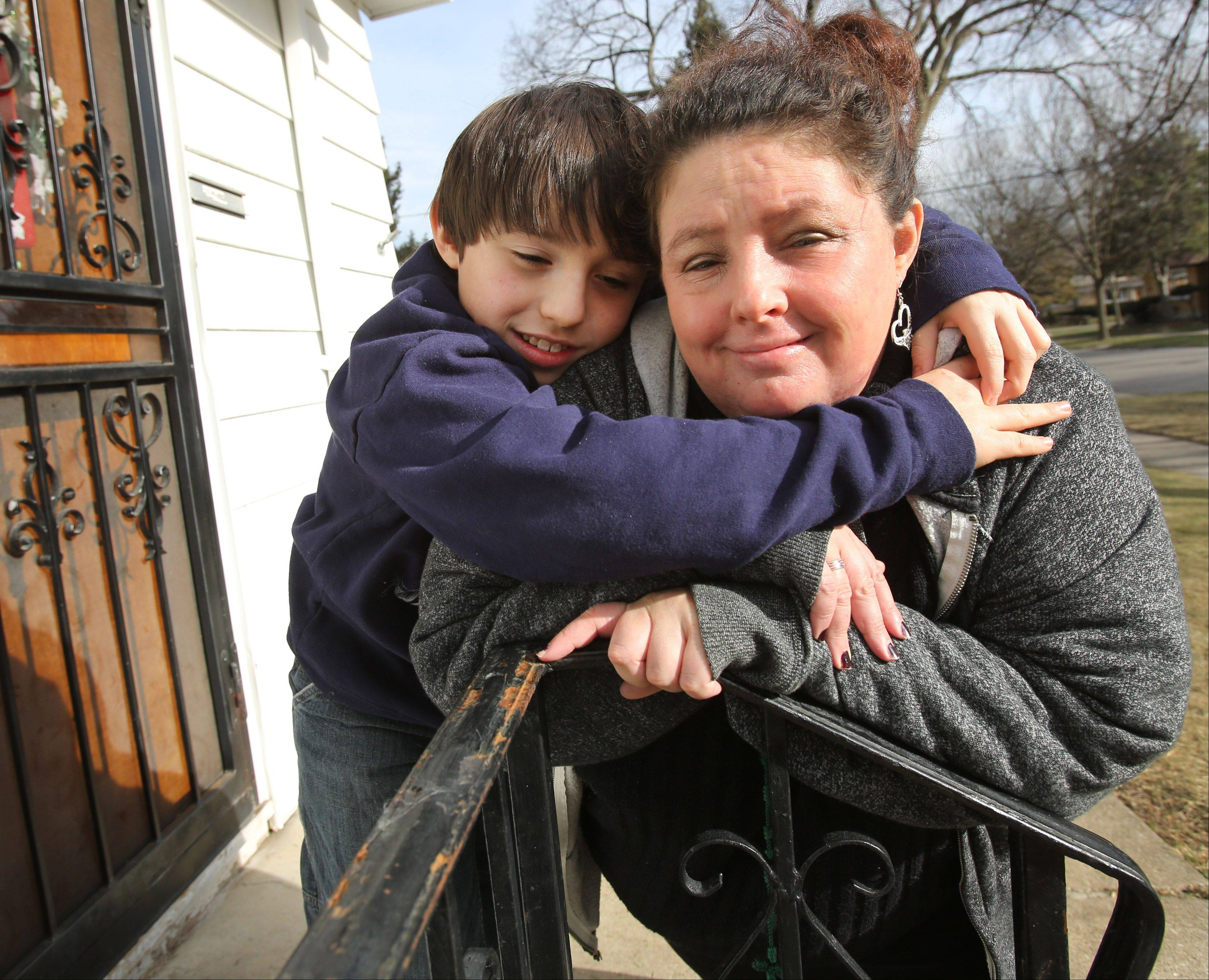 Susan Cloutier-Regan and her son Gabriel, 10, at their Villa Park home. Gabriel attends the School of Expressive Arts and Learning in Lombard and she is concerned with the wetlands surrounding the new school.