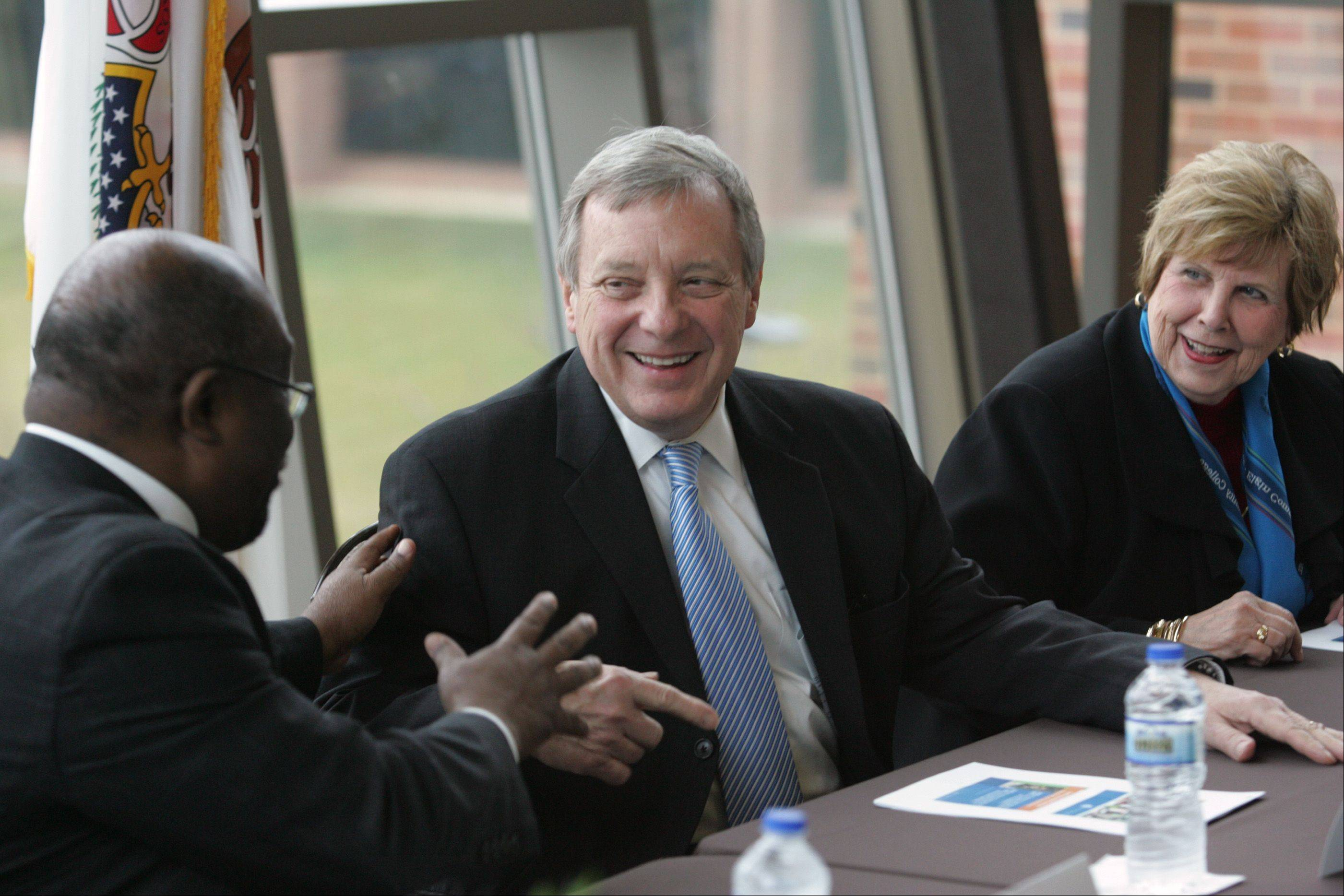 Sen. Dick Durbin laughs as he talks with Elgin Community College President David Sam Friday at the Elgin campus. Behind him is ECC trustee Eleanor MacKinney. Durbin met with ECC officials and students about how the college has dealt with student loan issues.