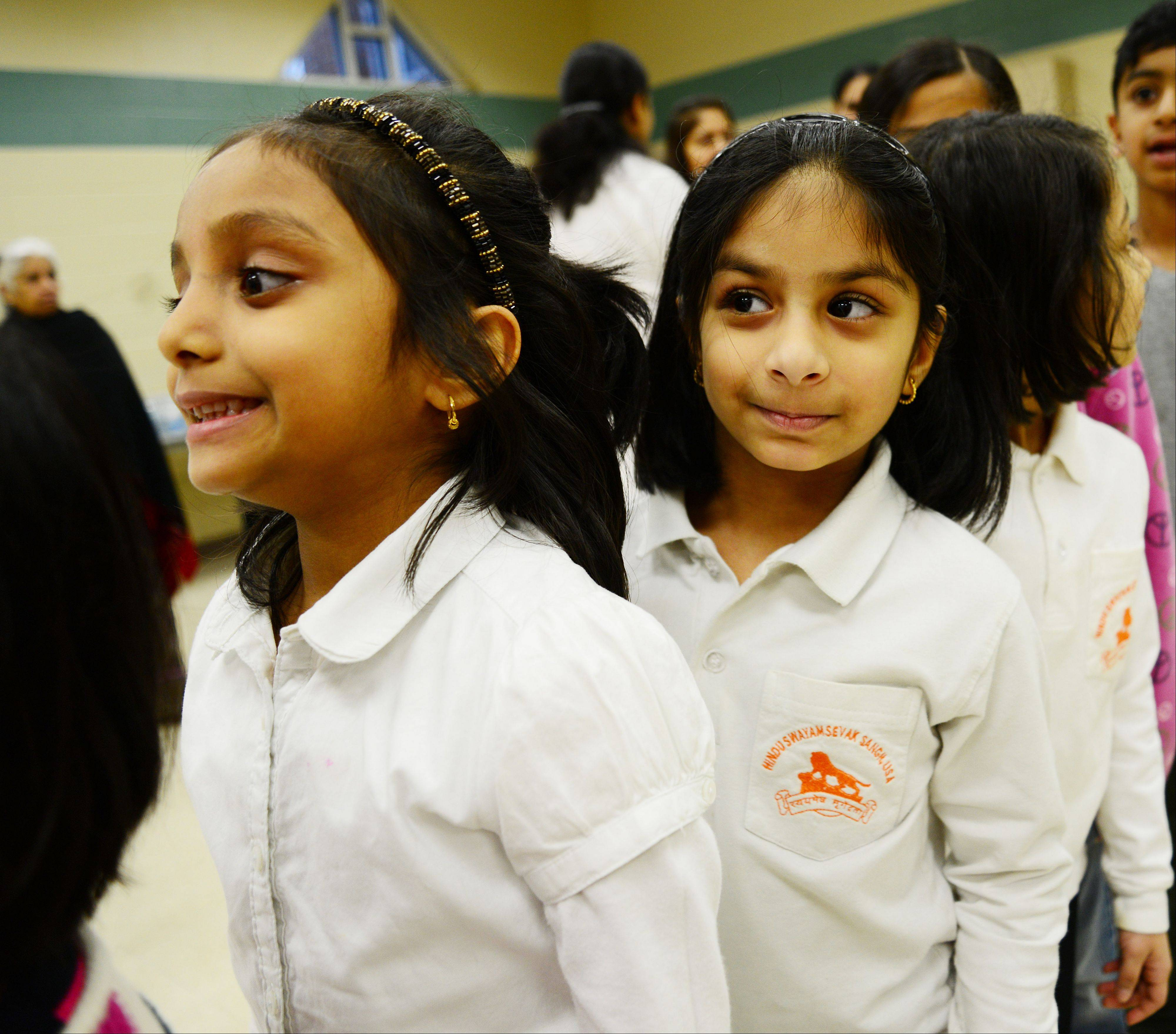 Anvitha Ellanki, 5, and Bhargaui Namboovi, 5, both of Naperville, are all smiles as they took part in the Naperville-Aurora chapter of HSS celebration of the 150th birth anniversary of Swami Vivekananda. He brought the eastern Hindu philosophy (including Yoga) to the USA for the first time in 1893. This event was held at the Eola Community Center in Aurora Saturday.