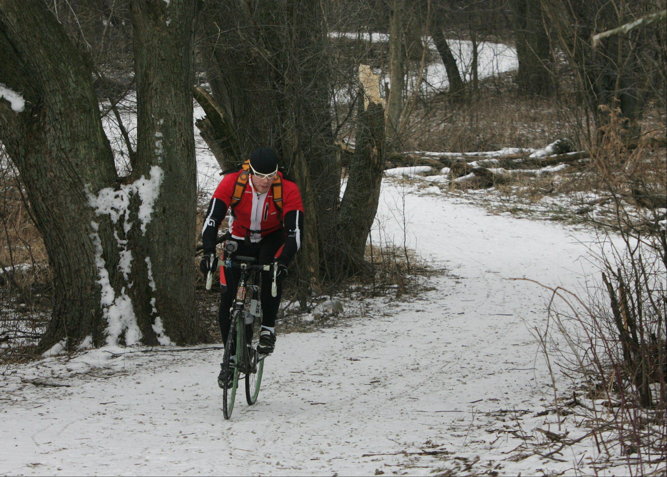 Ryan Faber, of Palatine, goes off-road cycling at Deer Grove East Forest Preserve in Palatine.