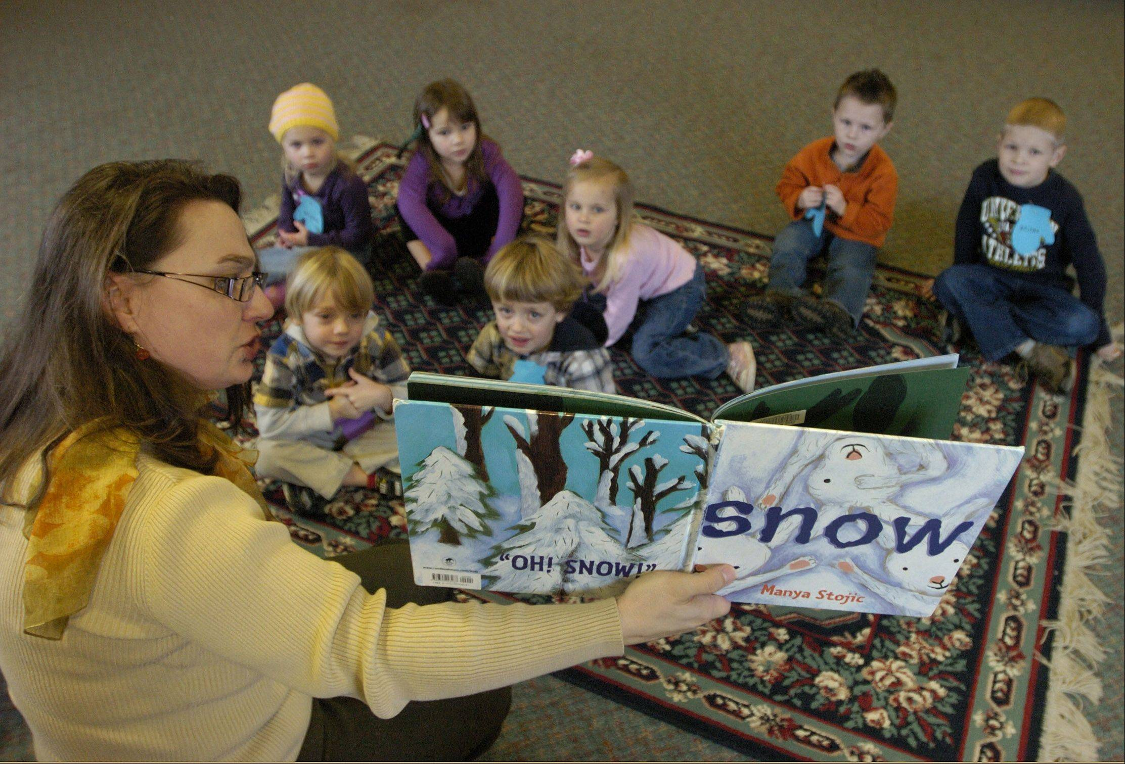 Head of Youth Services Kerry Reed, reads a winter story during family story time at the Lake Villa District Library.