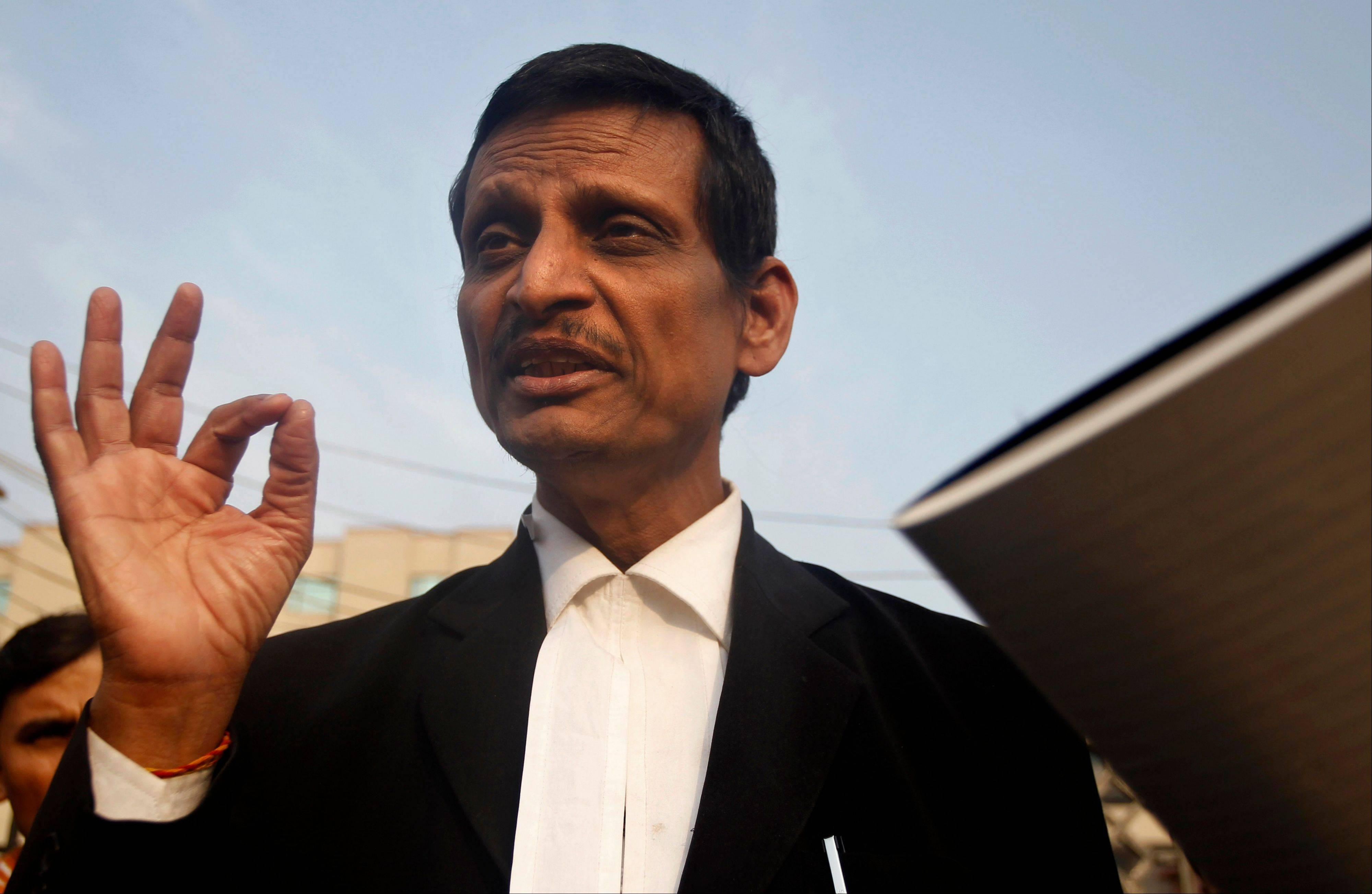Manohar Lal Sharma, lawyer for one of the accused, speaks to the journalists outside the Saket district court complex where the accused in a gang rape are to be tried in New Delhi, India, Monday. The lawyer for one of the five men charged in the fatal gang rape of a woman on a moving New Delhi bus said Monday that his client is a minor and asked a court to order a medical test to determine his age.