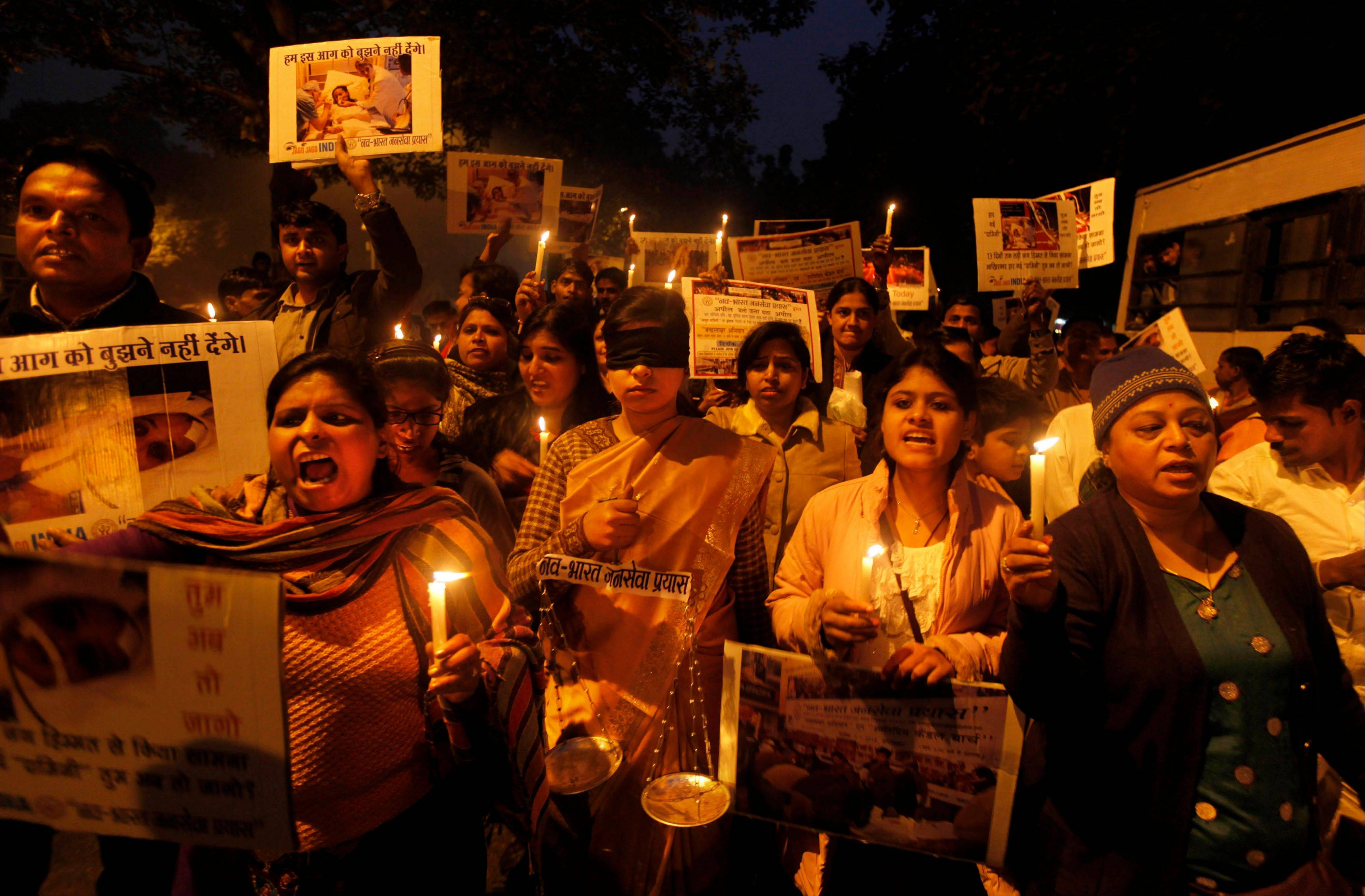 Indians take part in a candlelight vigil in New Delhi, India. Police said Sunday they have arrested six suspects in another gang rape of a bus passenger in India, four weeks after a brutal attack on a student on a moving bus in the capital outraged Indians and led to calls for tougher rape laws.