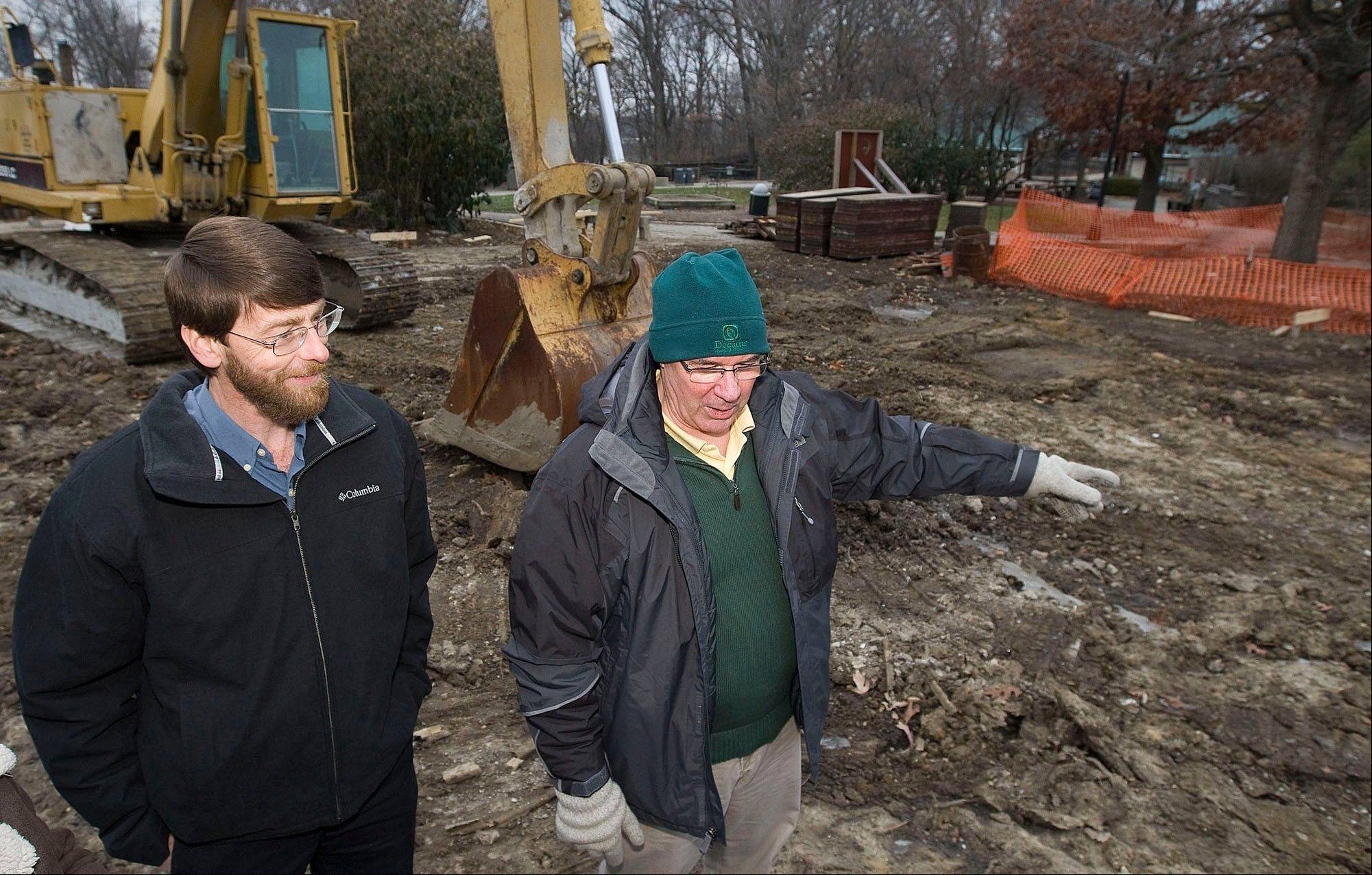 Associated PressScovill Zoo director Dave Webster, left, and Decatur Park District director of operations Jim Kiefer show the work that has recently started for the new penguin exhibit at the Scovill Zoo in Decatur.