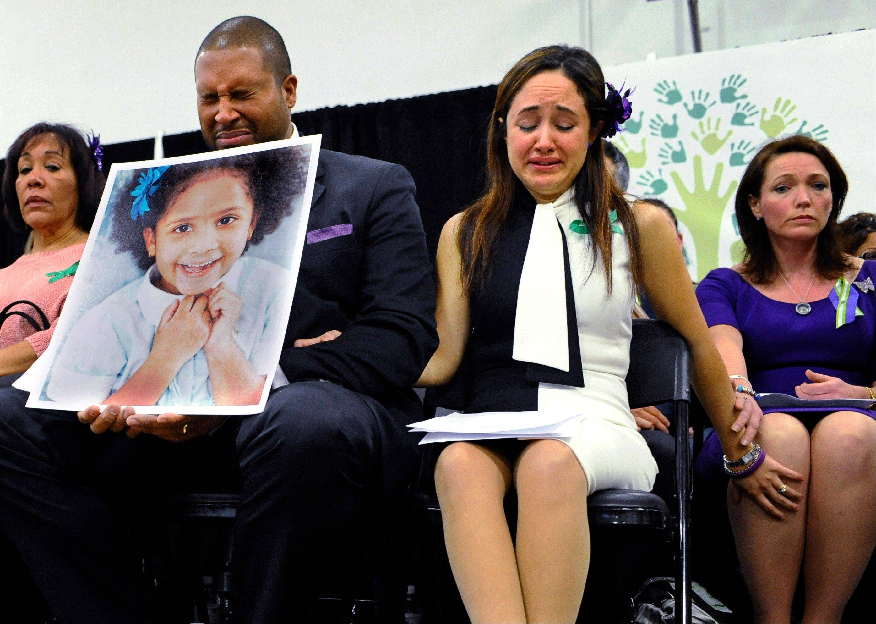 Jimmy Greene, foreground left, Nelba Marquez-Greene, center, parents of Sandy Hook Elementary School shooting victim Ana Marquez-Greene, and Nicole Hockley, right, mother of victim Dylan Hockley, were among Sandy Hook parents who joined a grassroots initiative to support solutions for a safer community.