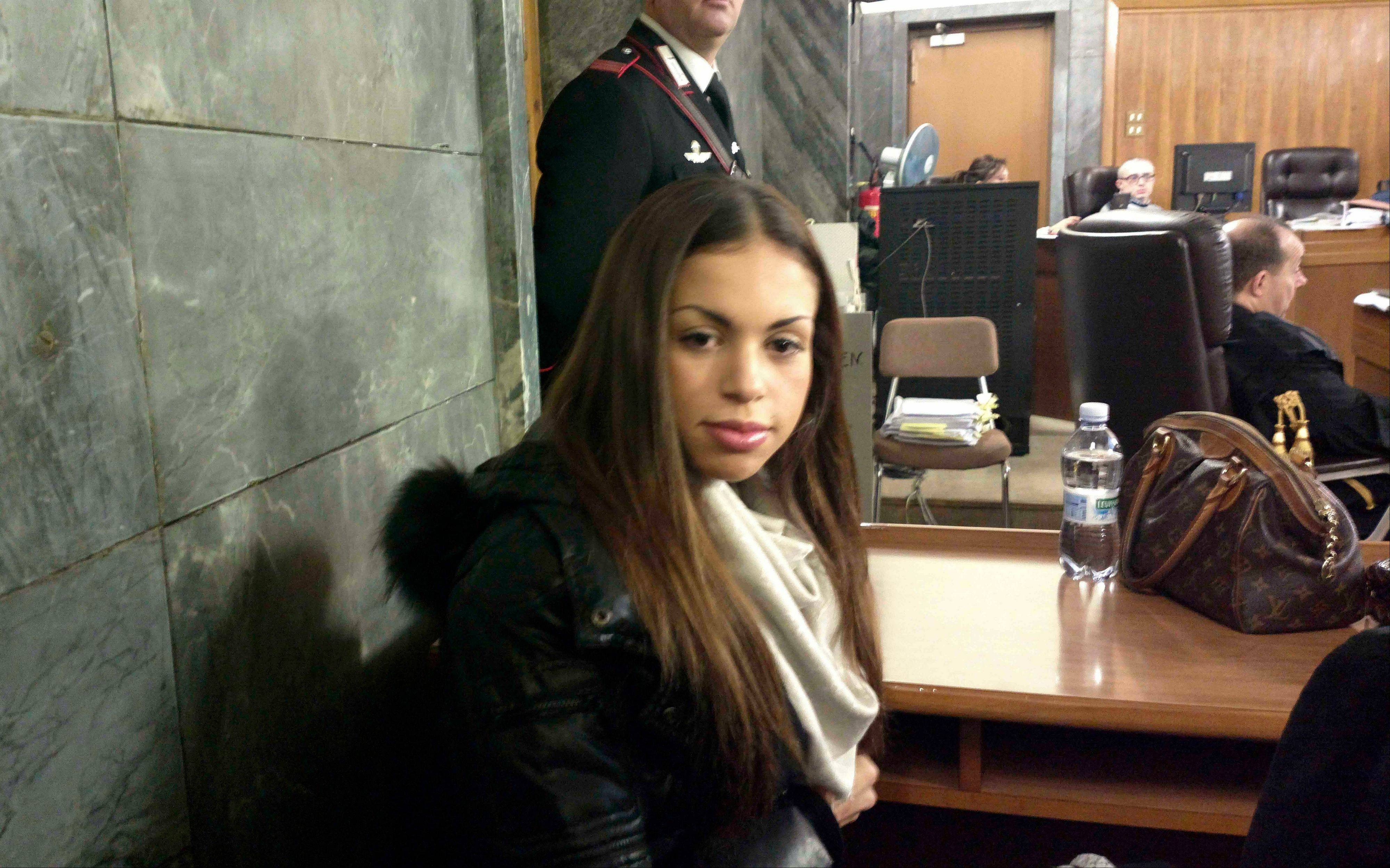 Karima el-Mahroug, the Moroccan woman at the center of ex-Premier Silvio Berlusconi's sex-for-hire trial, sits in a courtroom prior to to testifying as a witness for the first time, in Milan, Monday. Berlusconi is accused of paying for sex with woman, better known as Ruby, when she was 17, and then trying to cover it up. Both deny sexual contact.