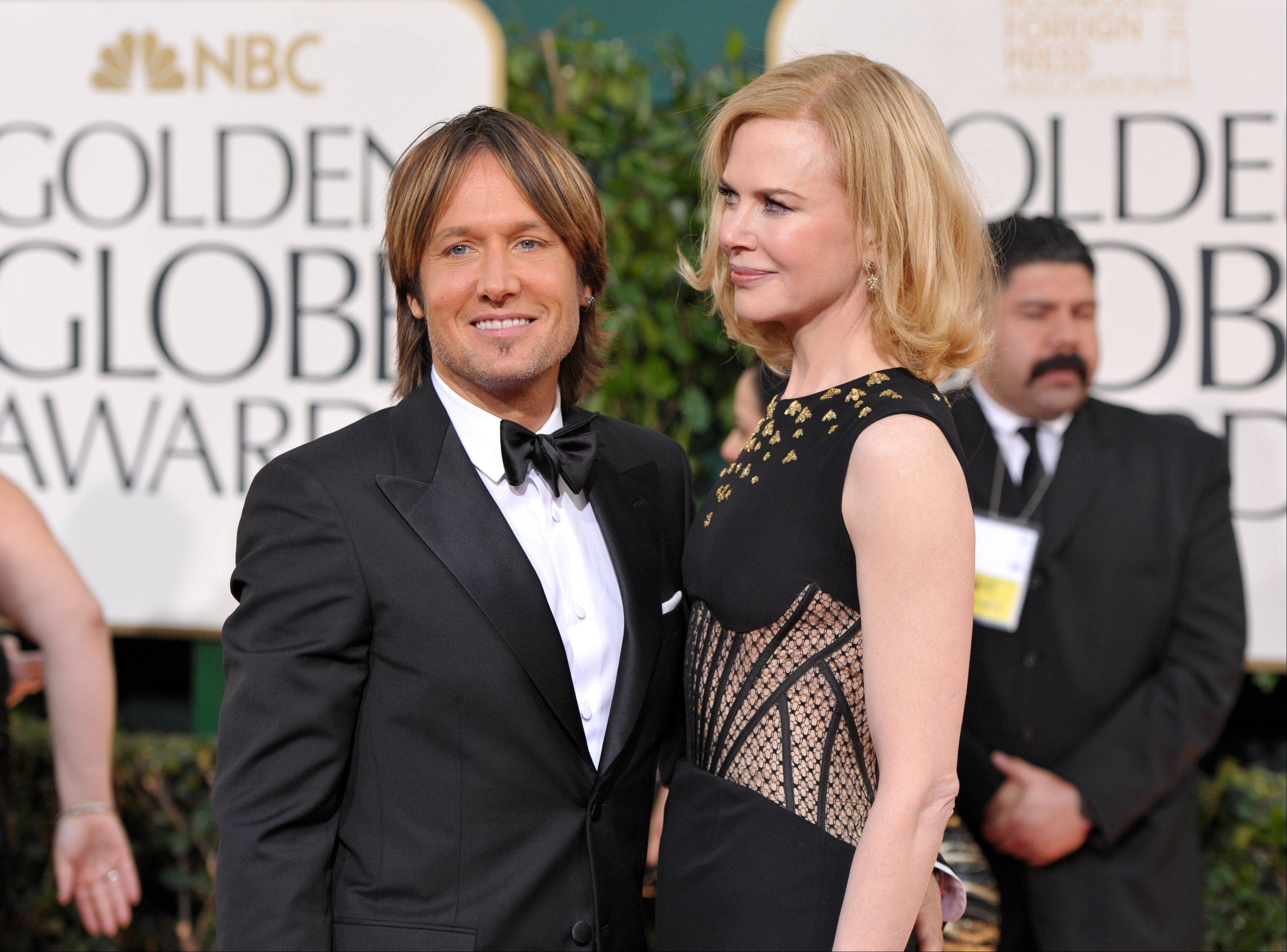 Musician Keith Urban, left, and actress Nicole Kidman arrive at the 70th Annual Golden Globe Awards at the Beverly Hilton Hotel on Sunday Jan. 13, 2013, in Beverly Hills, Calif.