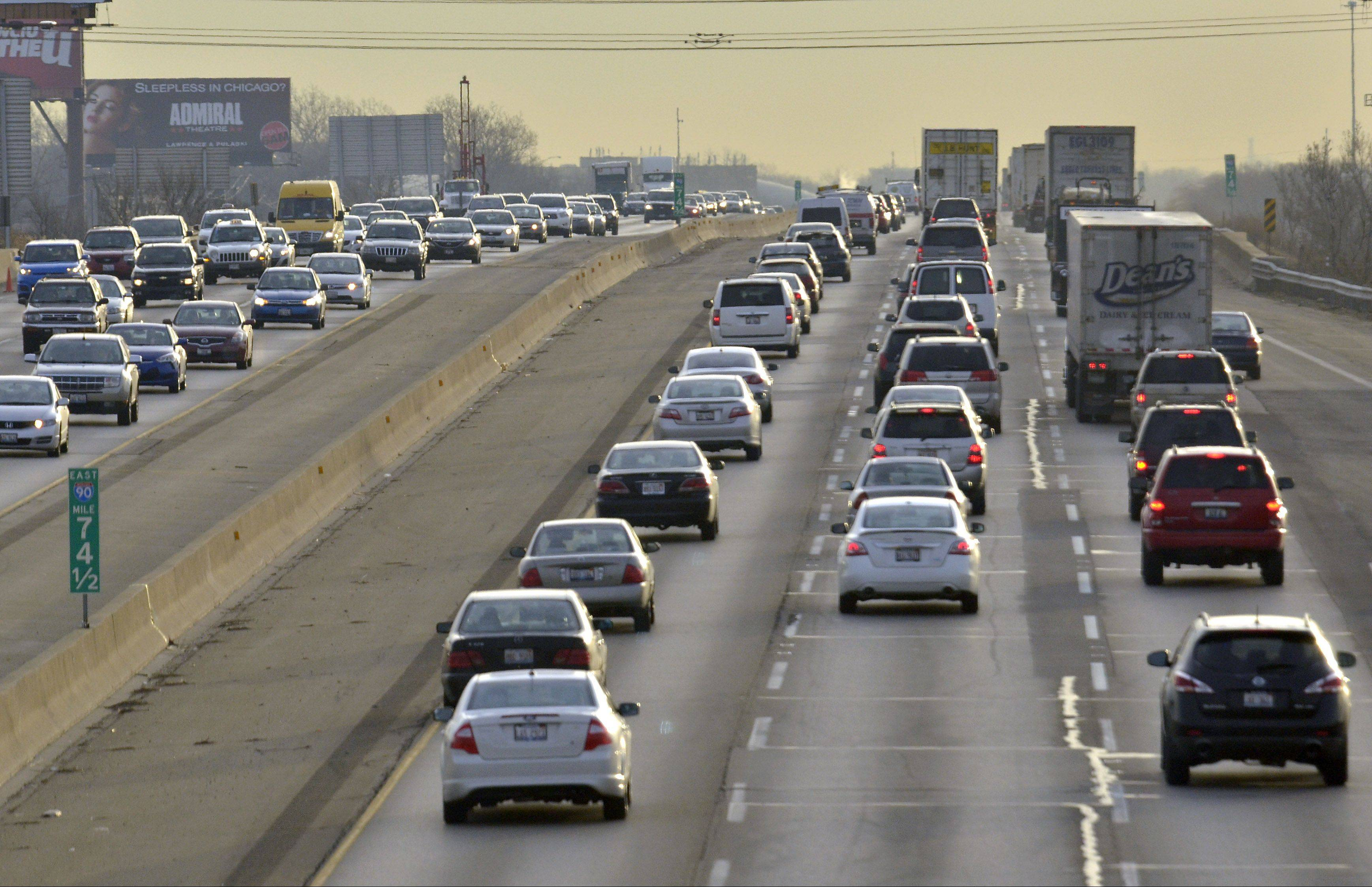 Traffic is heavy in both directions during the morning rush looking east on I-90, east of the Des Plaines Oasis. The Illinois State Toll Highway Authority will widen the tollway during the next four years.