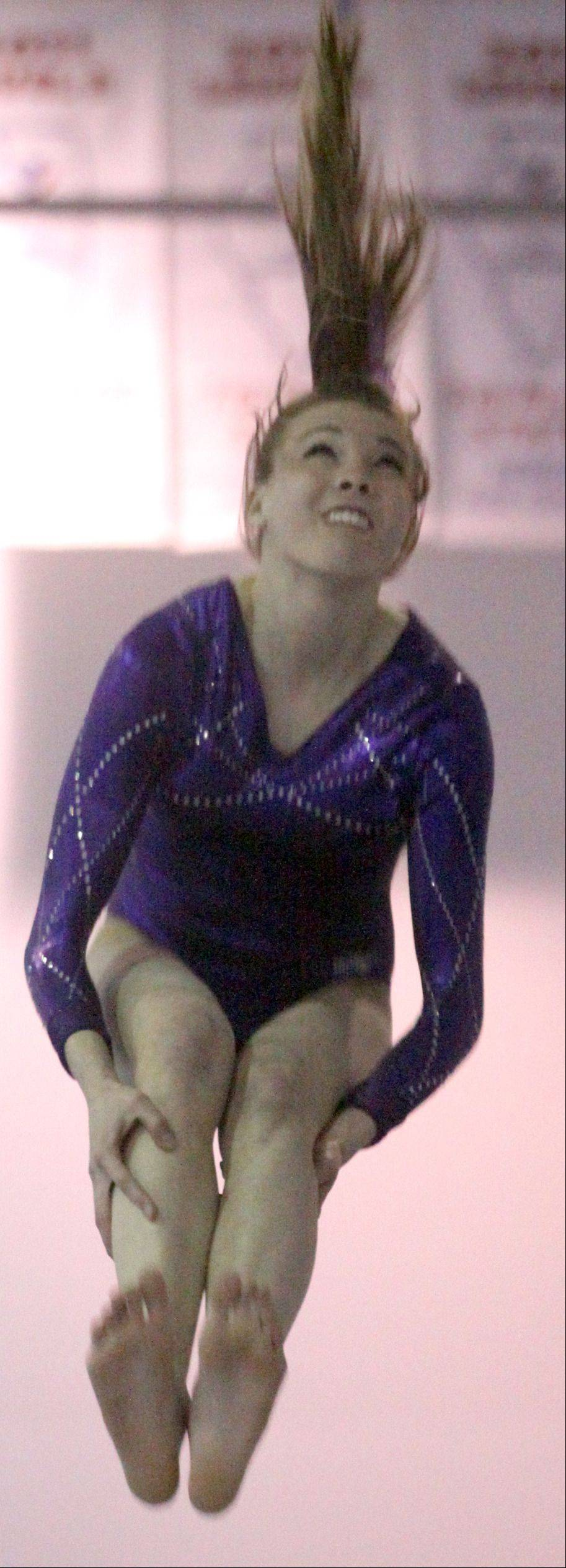 St. Charles co-op's Sidney Copeland participates in the vault competition during a gymnastics meet at St. Charles Gymnastics Academy on Monday night.
