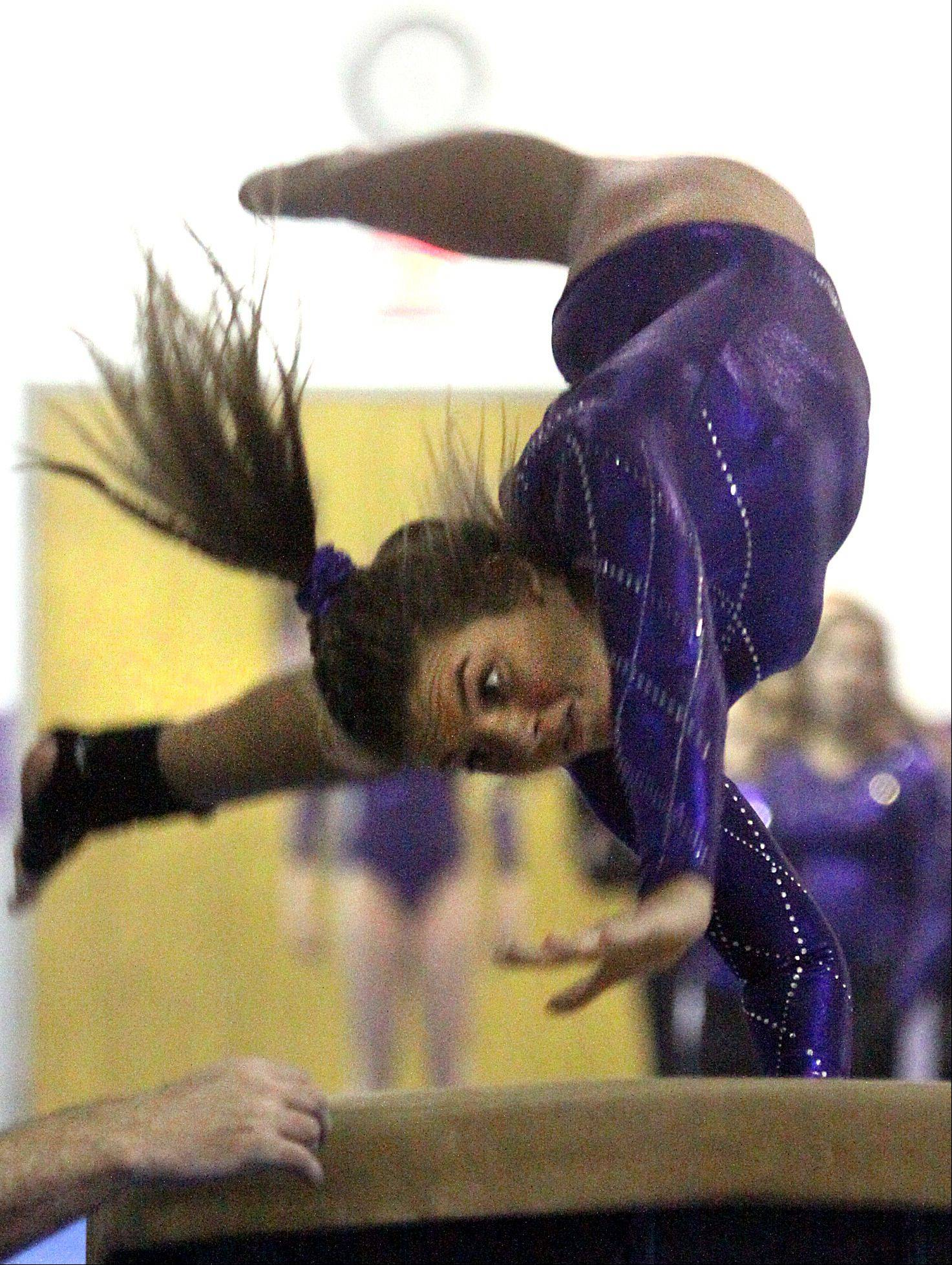 St. Charles co-op's Jesi Ortiz participates in the vault competition during a gymnastics meet at St. Charles Gymnastics Academy on Monday night.