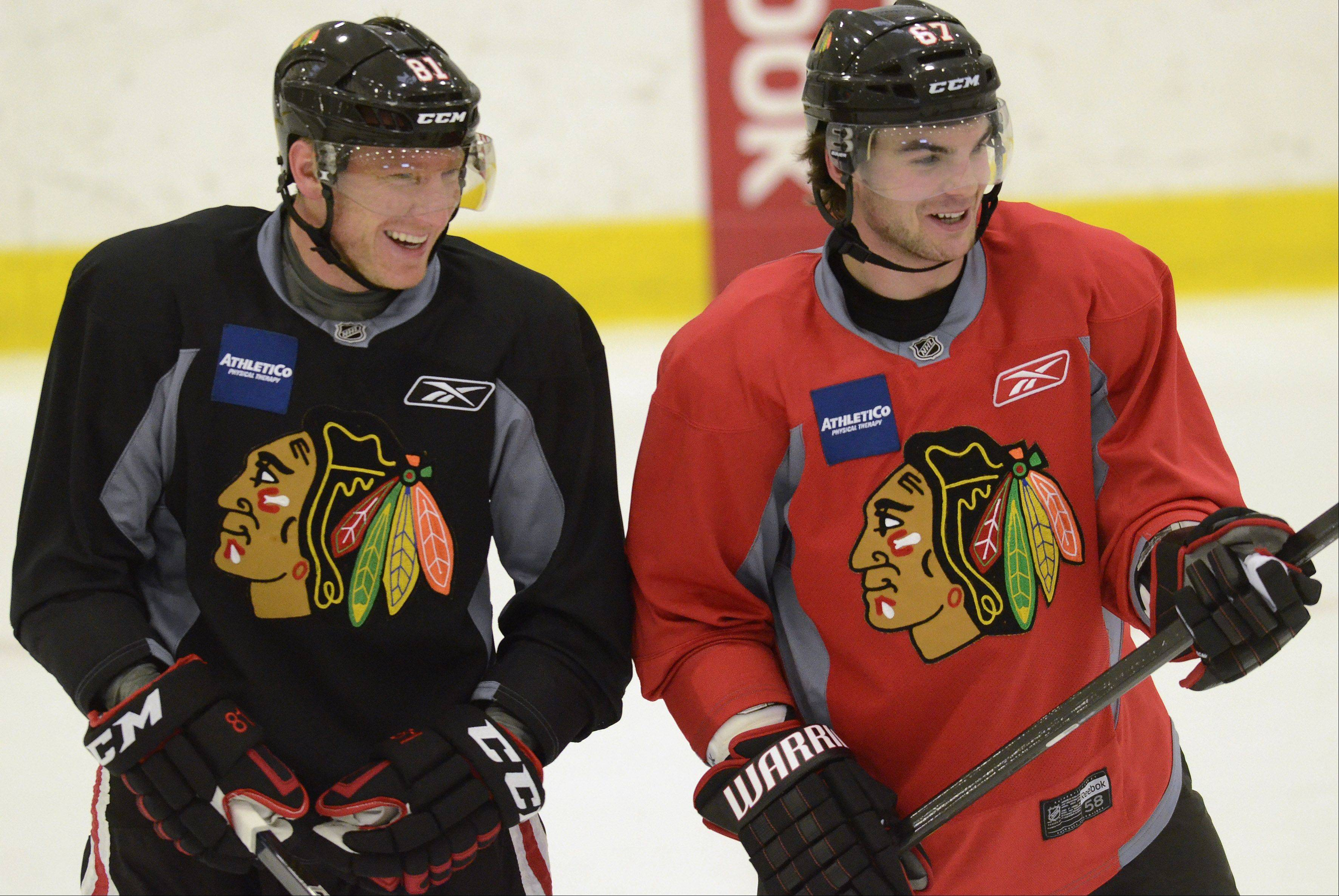 Fellow countrymen Marian Hossa and Michael Frolik share a laugh during Blackhawks informal practice at Johnny's Ice House Thursday.