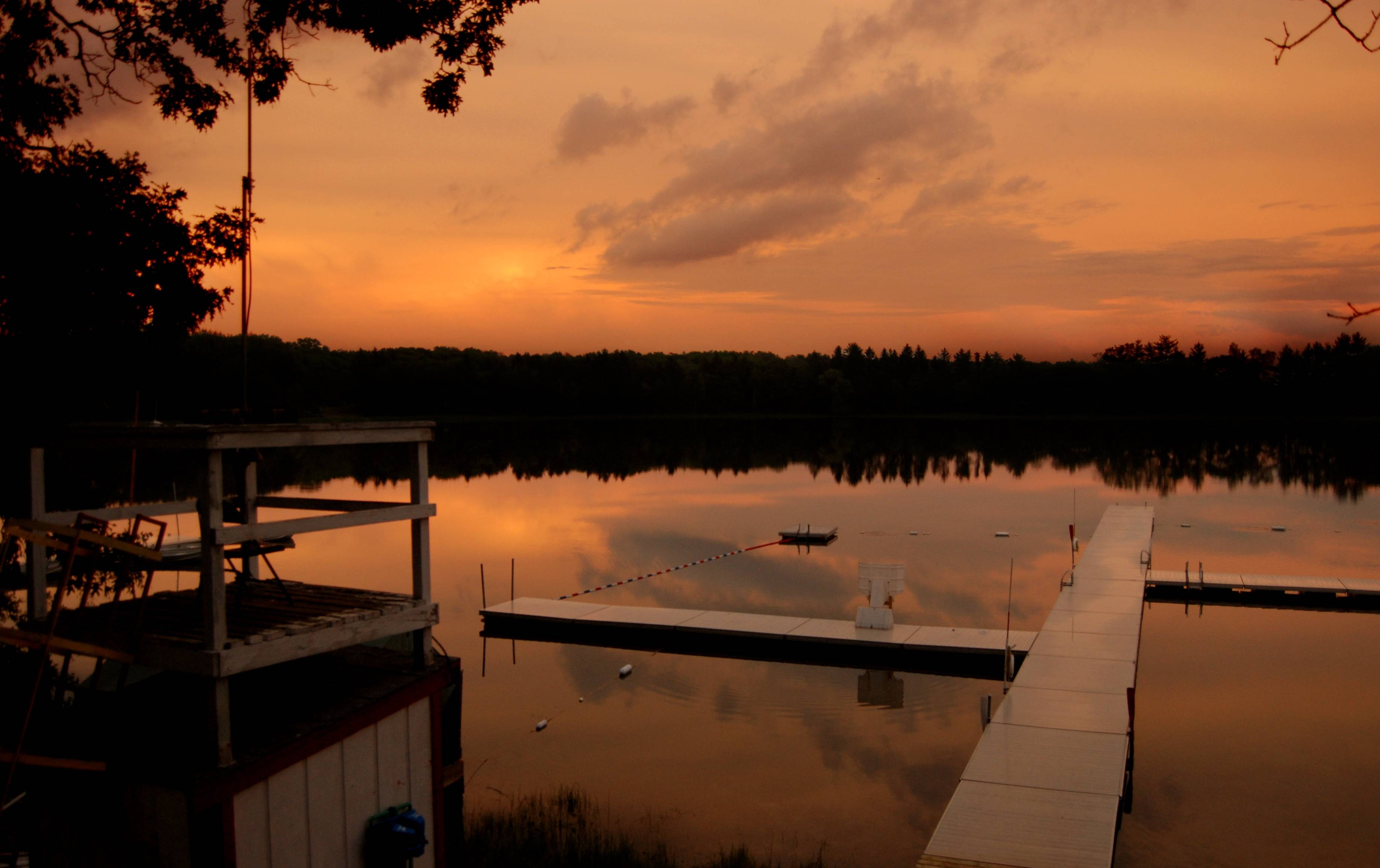 A view of Camp Freeland Leslie's waterfront at sunset. The Friends of Scouting and Camp Card Campaigns provide support for the operation and maintenance of camping properties, and teaches Scouts how to earn their way to camp.