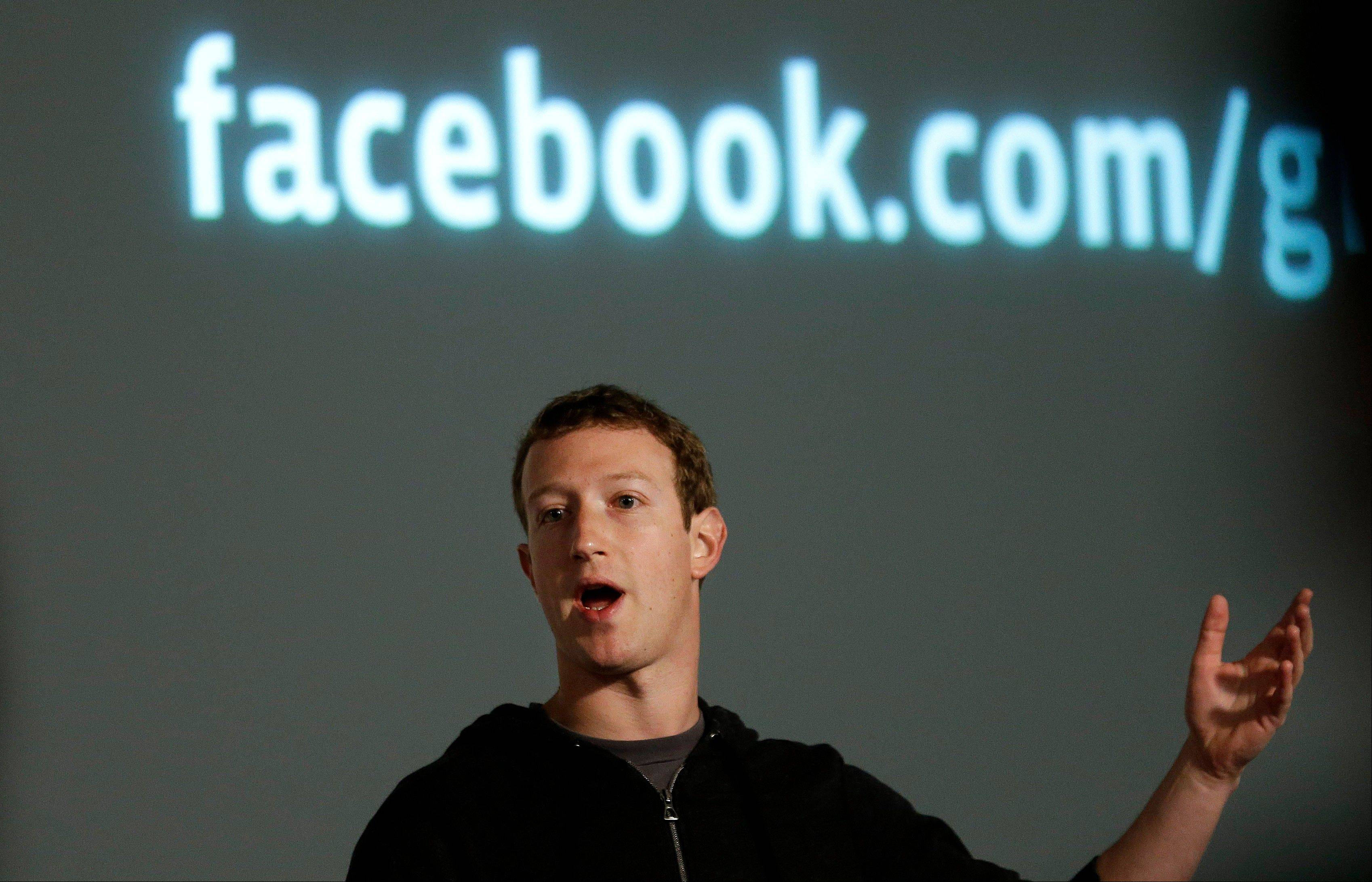 "Facebook CEO Mark Zuckerberg introduces ""graph search"" Tuesday, a new service that lets users search their social connections for information about their friends' interests and for photos and places. (AP Photo/Jeff Chiu)"