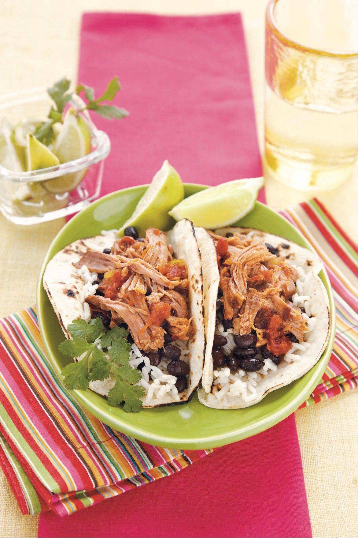 Slow-cooker dinners, like these pork tacos from �Southern Living Big Book of Slow Cooking� make for simple and hearty winter fare.