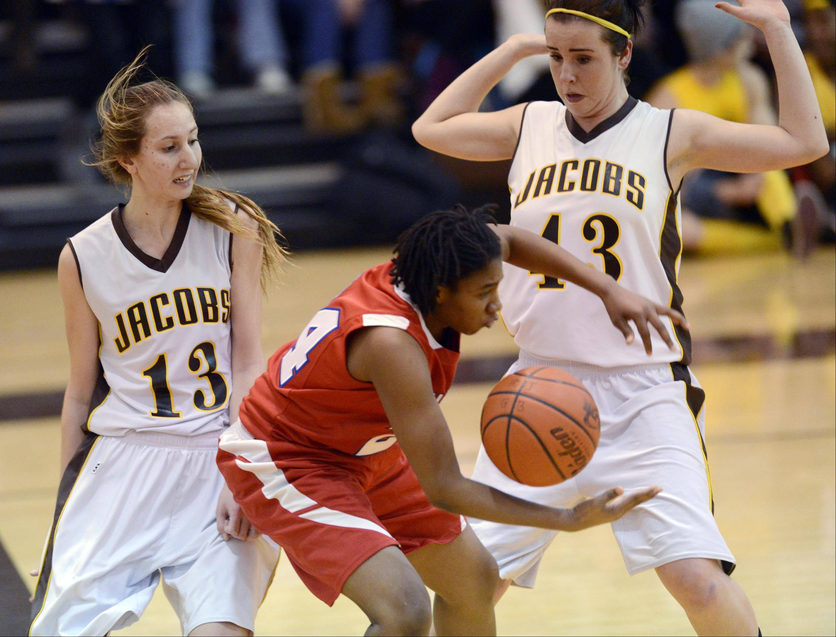 Dundee-Crown�s Jereneka Baker loses control of the ball under pressure from Jacobs� Victoria Tamburrino and Jackie Bartolai, right.