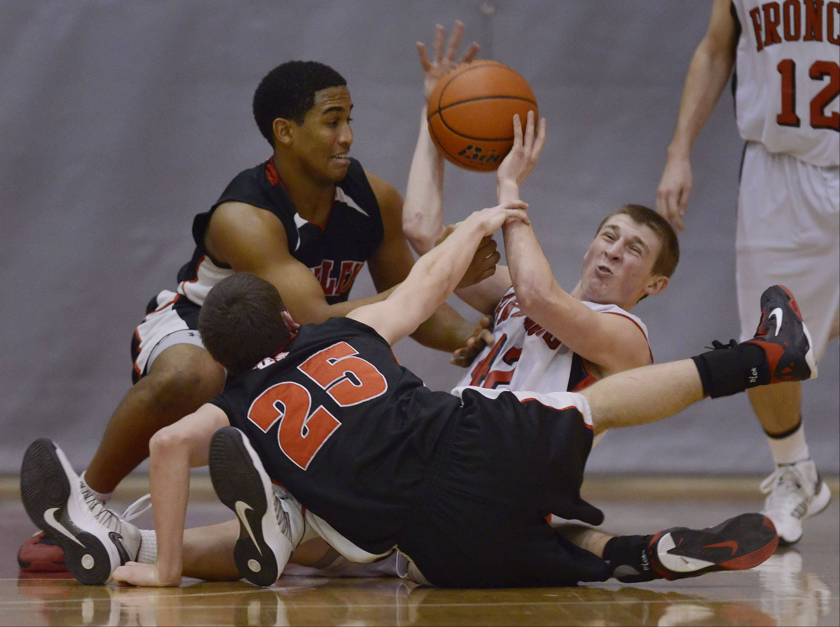 Barrington�s Robby Vollman, right, manages to pass the ball to a teammate after diving to the floor with Huntley�s Bryce Only, left, and Jason Shields.