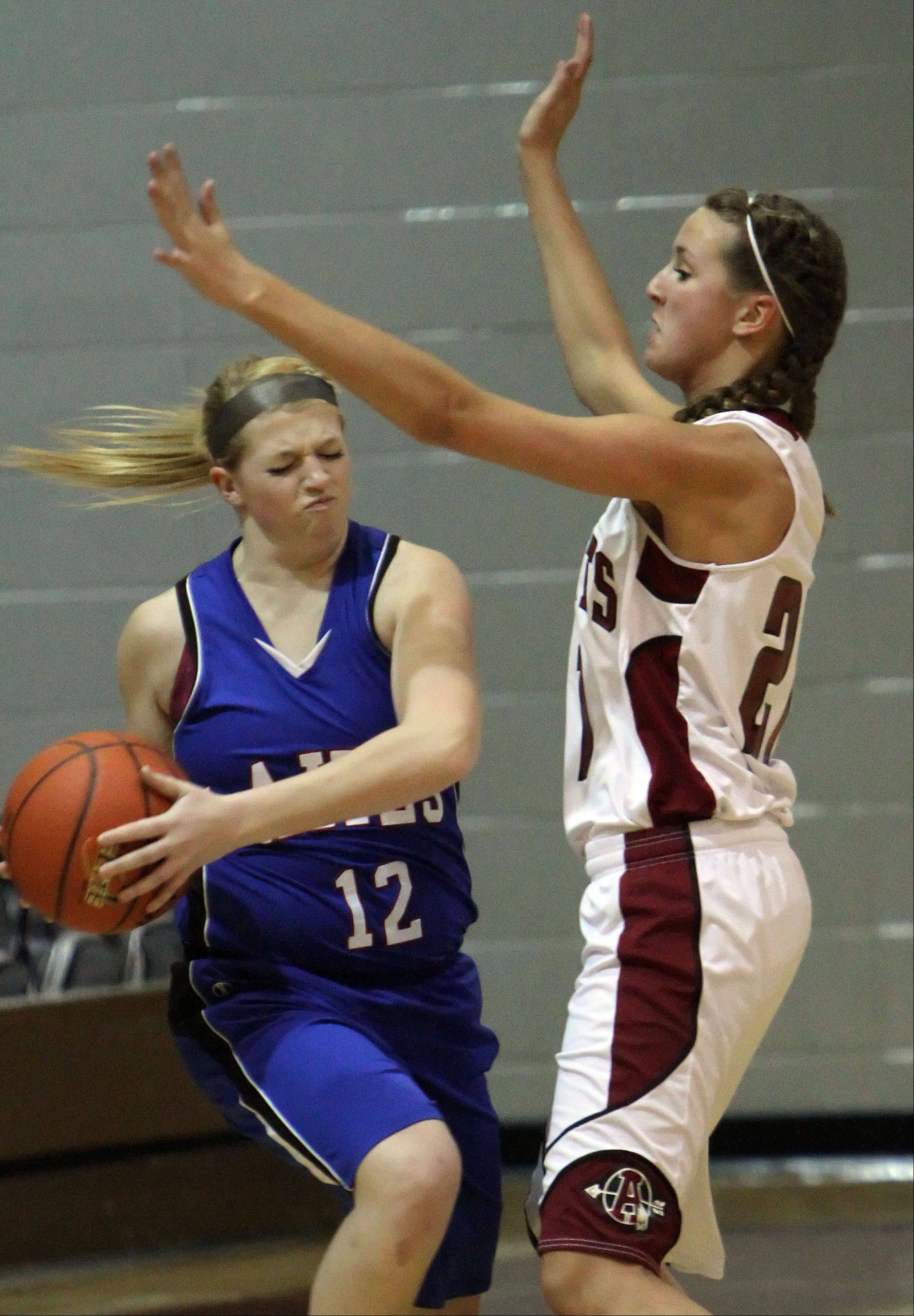 Lakes� Dayna Olson, left, tries to get around Antioch�s Carly McCameron.