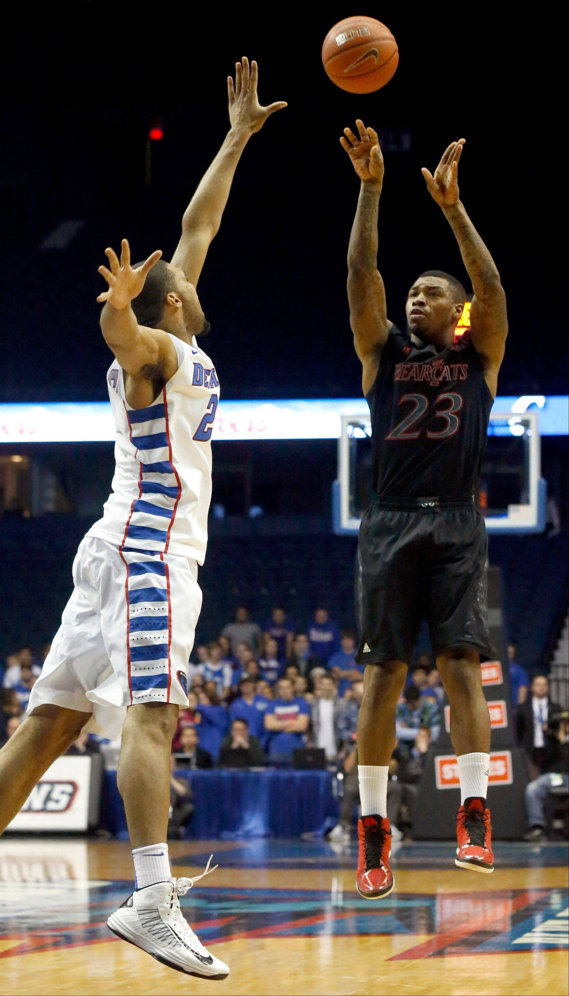 Cincinnati guard Sean Kilpatrick (23) shoots over DePaul forward Donnavan Kirk during the first half of an NCAA college basketball game, Tuesday, Jan. 15, 2013, in Rosemont, Ill. (AP Photo/Charles Rex Arbogast)