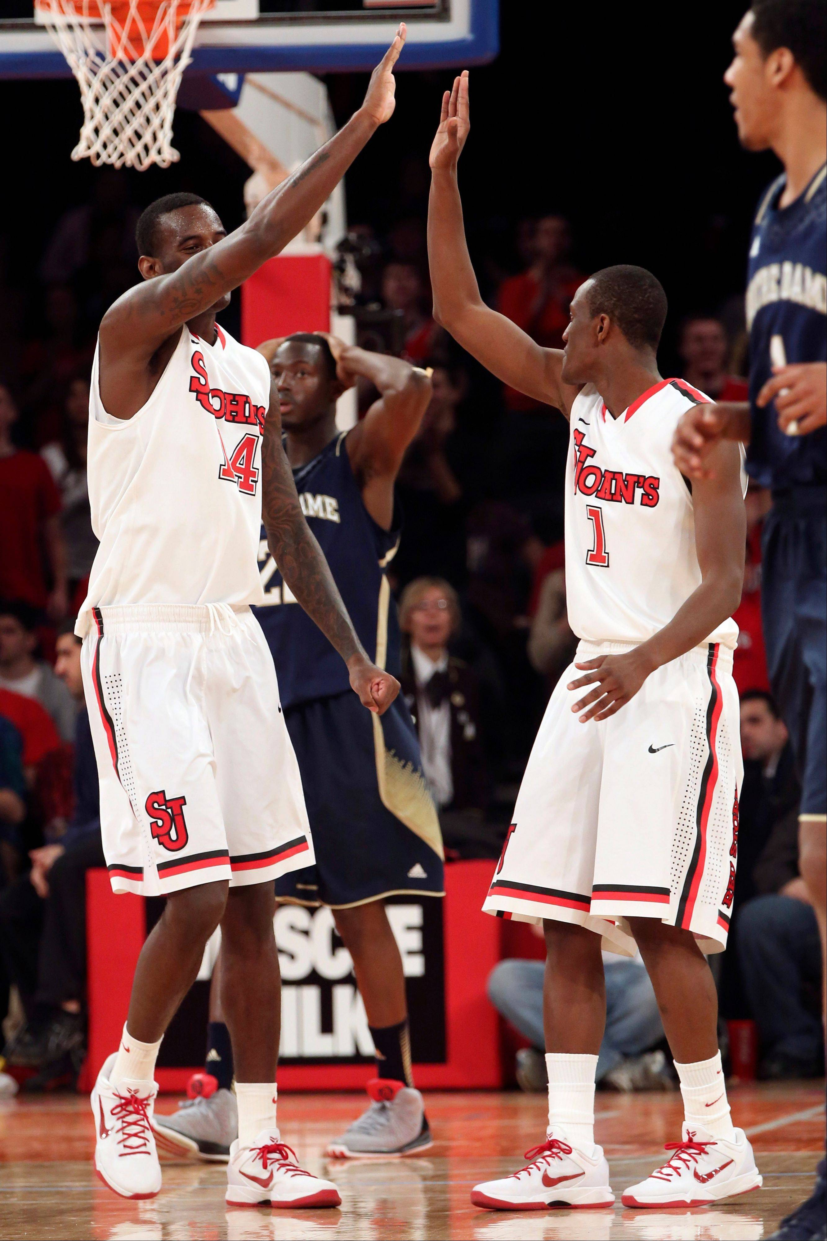 St. John's Jakarr Sampson, left, and Phil Greene IV celebrate a call during the second half of the NCAA college basketball game against Notre Dame, Tuesday, Jan. 15, 2013, at Madison Square Garden in New York. St. John's won 67-63. (AP Photo/Mary Altaffer)