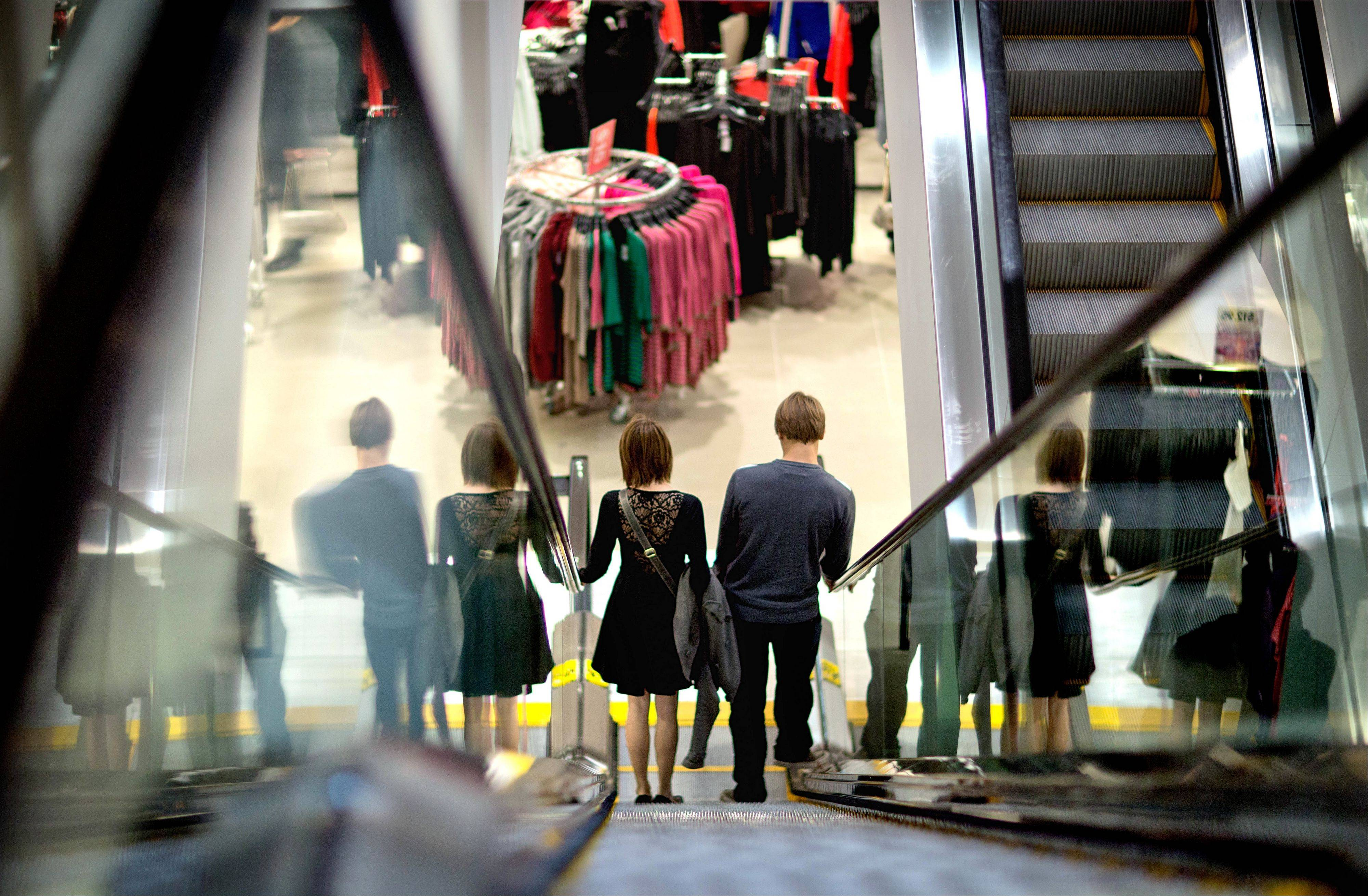 U.S. consumers increased their spending at retail businesses in December, buying more autos, furniture and clothing.