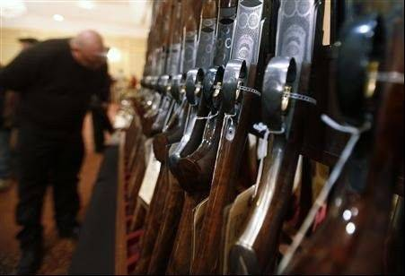 A weapons industry group based in the Connecticut town where a gunman killed 20 children, six adults and himself last month is hosting a Las Vegas trade show for tens of thousands of gun and gear manufacturers and enthusiasts.