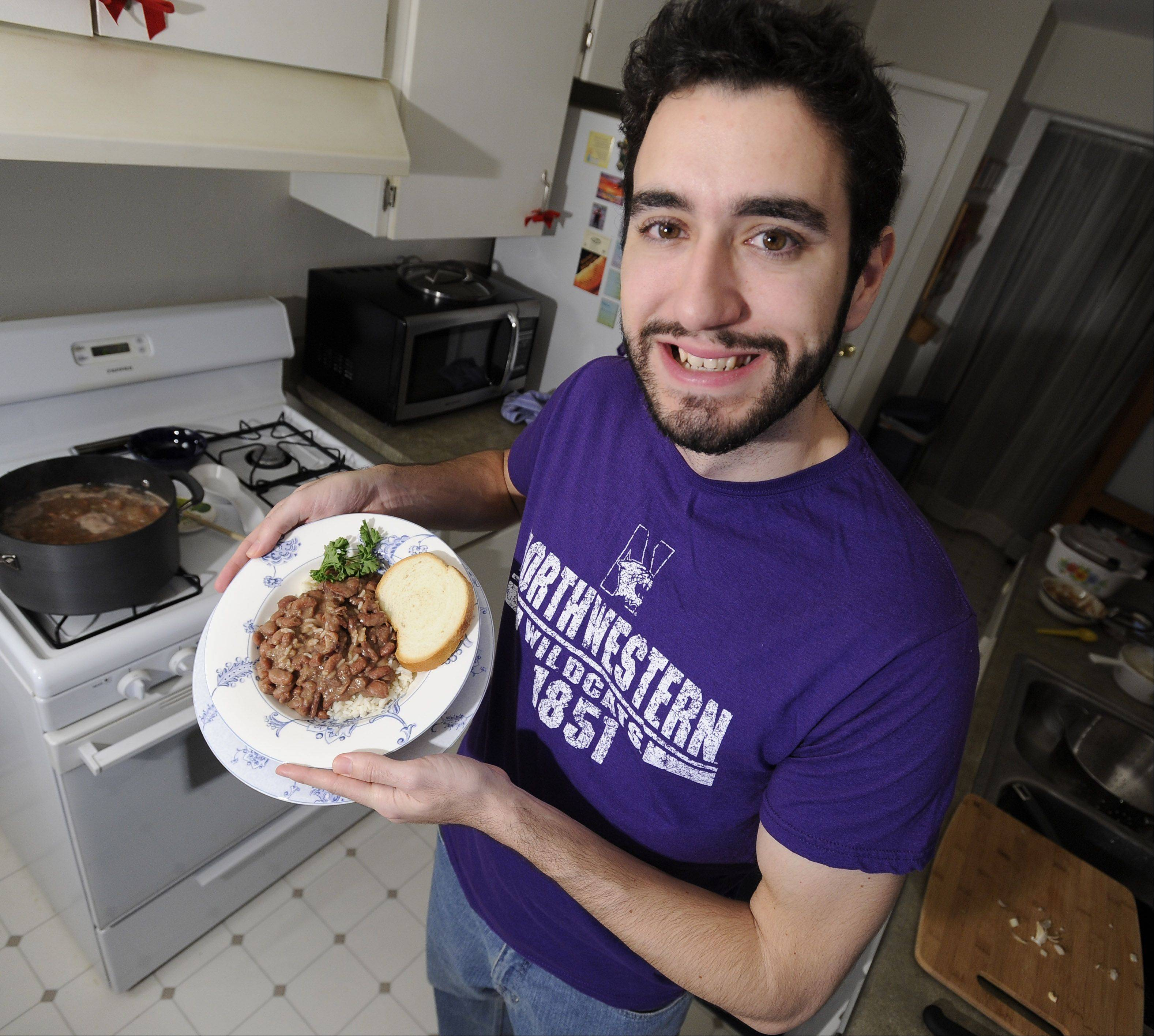 Andrew Ledet of Elk Grove Village hold up his mom's red beans and rice.