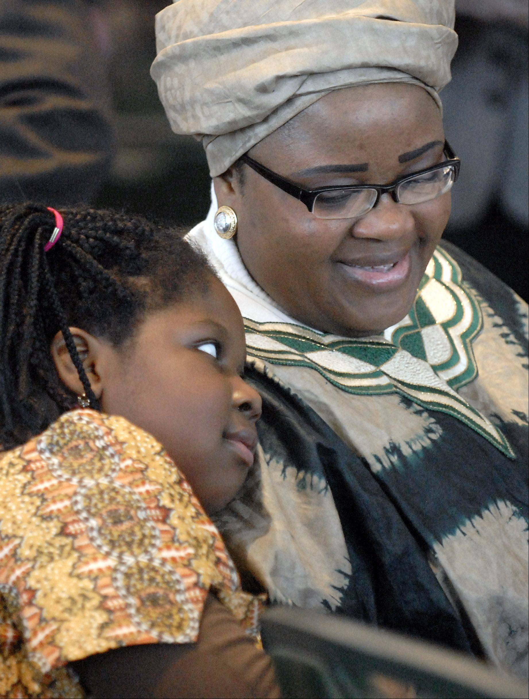 Zoe-Anna Wilson, 7, of Bolingbrook rests her head on her mother Daisy Viyuoh's shoulder during the 27th annual Dr. Martin Luther King, Jr., Prayer Breakfast held at The Centre in Elgin last year. Zoe-Anna's elder sister, Phebe, 8, also joined them. It was their first time attending the event.